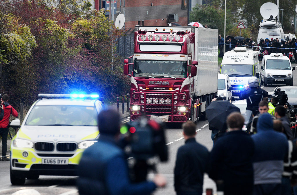 A truck in which 39 bodies were discovered in the trailer is driven from the site to a secure location where further forensic investigation can take place, on October 23, 2019 in Thurrock, England.