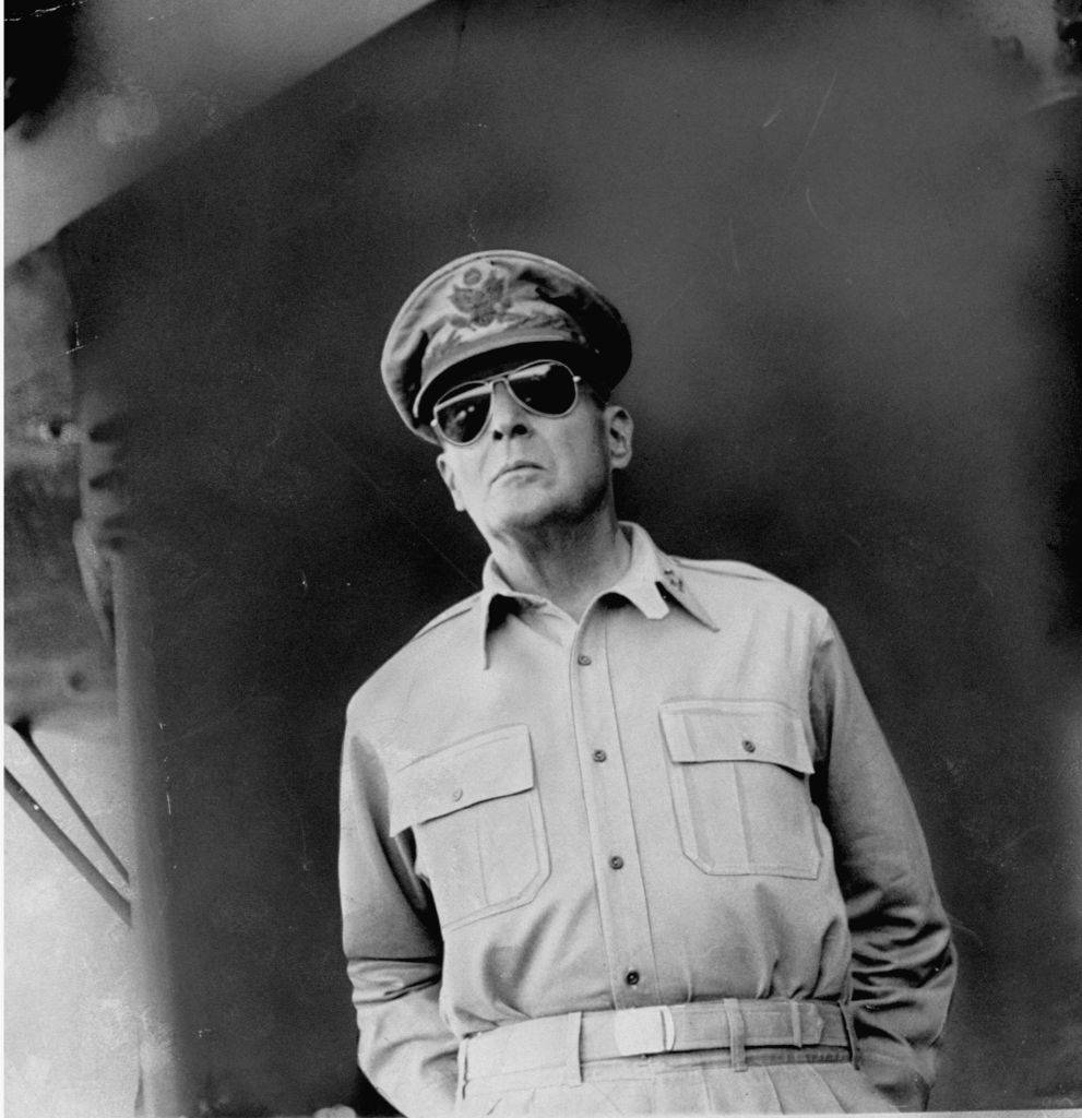 Gen. Douglas MacArthur on deck of a ship en route to USAF landing site at Lingayen Gulf in World War II return to the Philippine Islands.