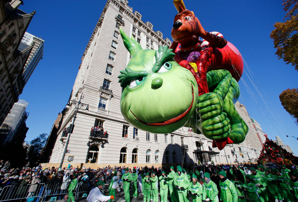 The Grinch balloon floats down Central Park West during the 92nd Annual Macy's Thanksgiving Day Parade on November 22, 2018 in New York City.