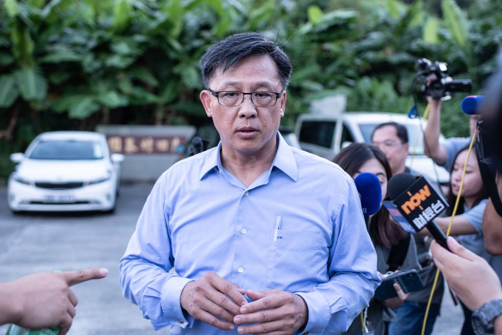 This picture taken on July 23, 2019 shows Hong Kong pro-Beijing government lawmaker Junius Ho leaving the cemetery after learning his parents' gravestones were vandalised in the Tuen Mun district of Hong Kong.