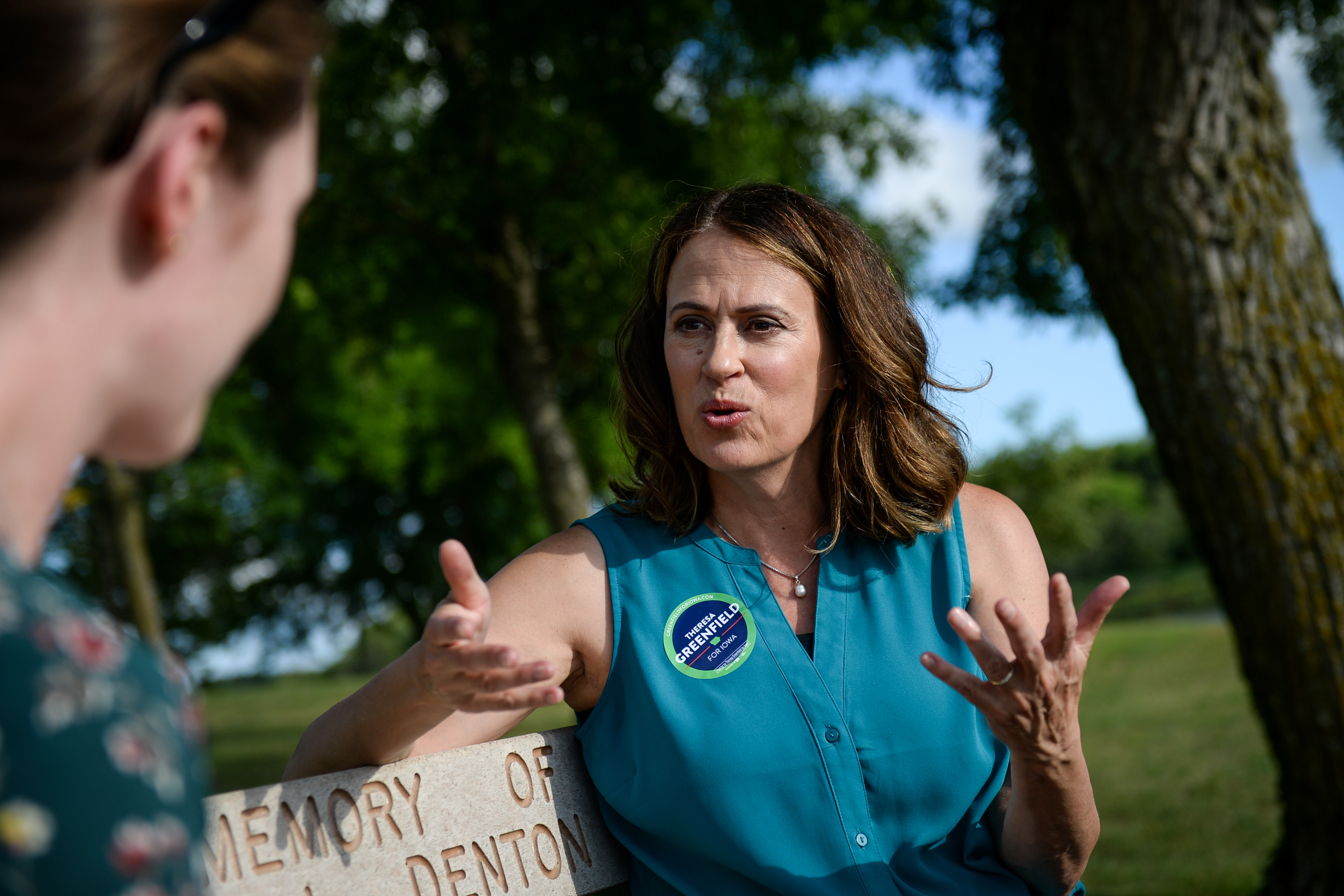 Democratic senate candidate Theresa Greenfield speaks with a reporter at a picnic hosted by the Adair County Democrats in Greenfield, Iowa on Sunday August 11, 2019.