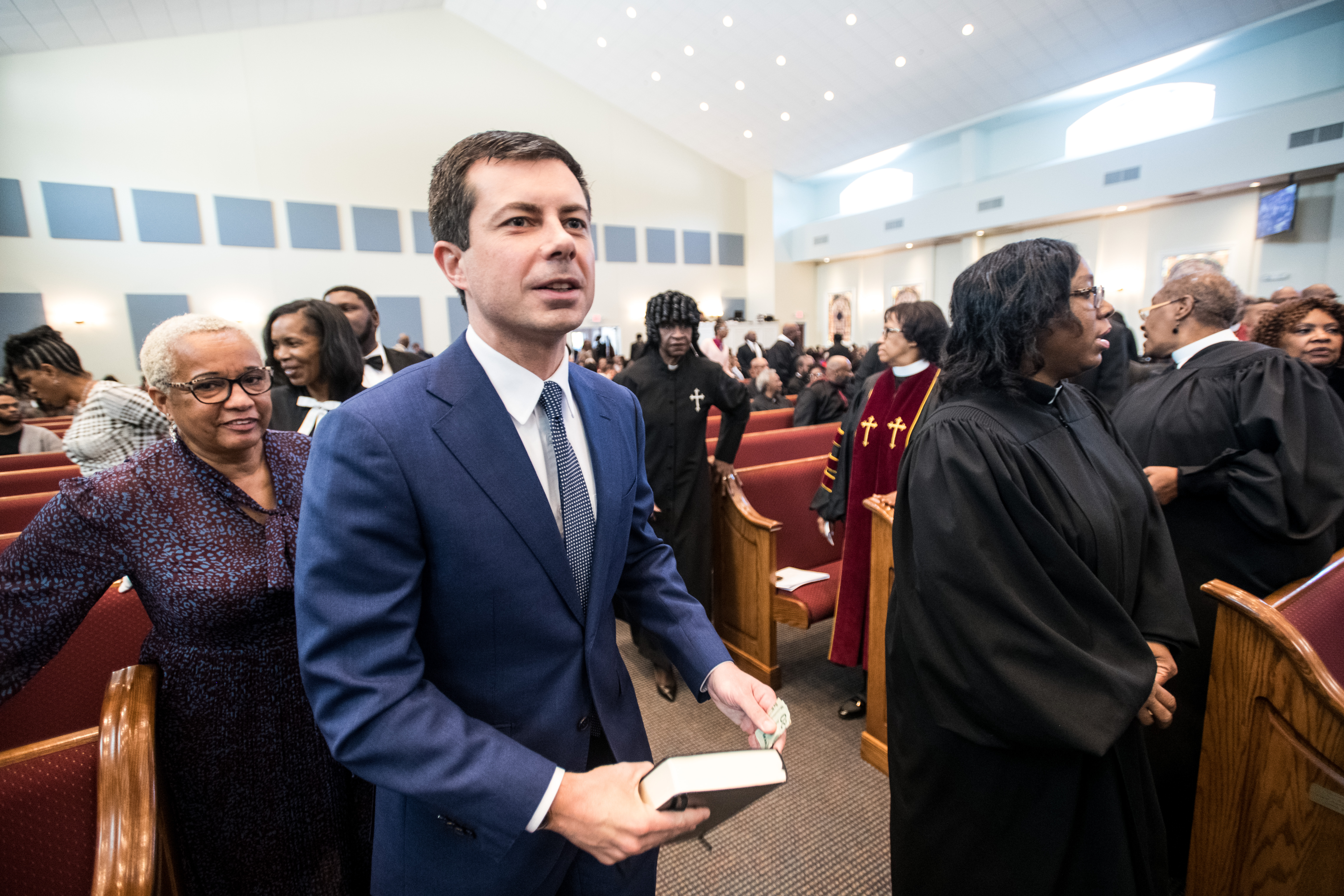 Democratic presidential candidate, South Bend, Indiana Mayor Pete Buttigieg exits a church pew during Sunday service at the Kenneth Moore Transformation Center in Rock Hill, South Carolina on Oct. 27, 2019.