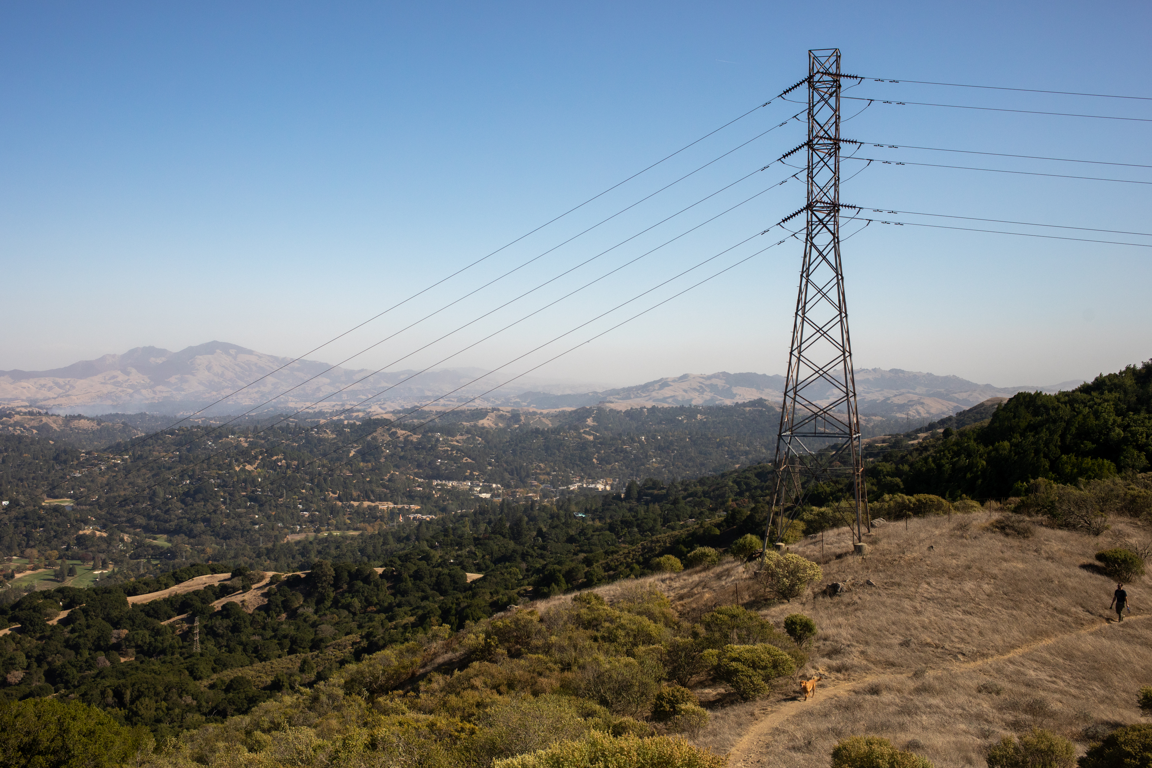 Smoke rises from the Lafayette Fire, left, as seen from Orinda, California, U.S., on Sunday, Oct. 27, 2019. In Lafayette, east of San Francisco, county fire officials are investigating a fallen PG&E transformer and a conductor that came into contact with a loose communication cable as the possible ignition sources of a blaze that forced evacuations, destroyed the Lafayette Tennis Club and damaged a home.