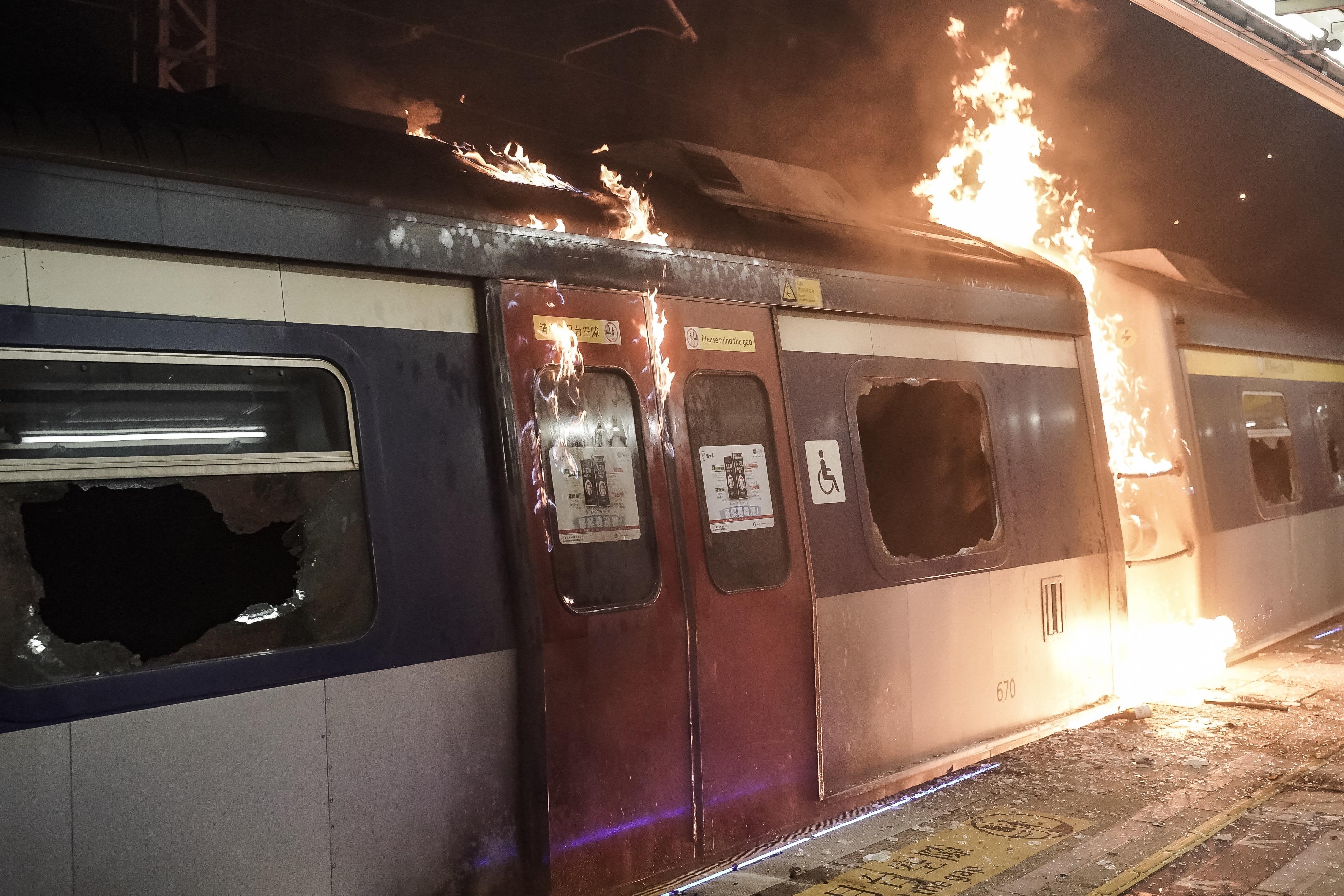 A train car burns at a MTR station during a demonstration at Chinese University of Hong Kong on November 13, 2019 in Hong Kong, China.