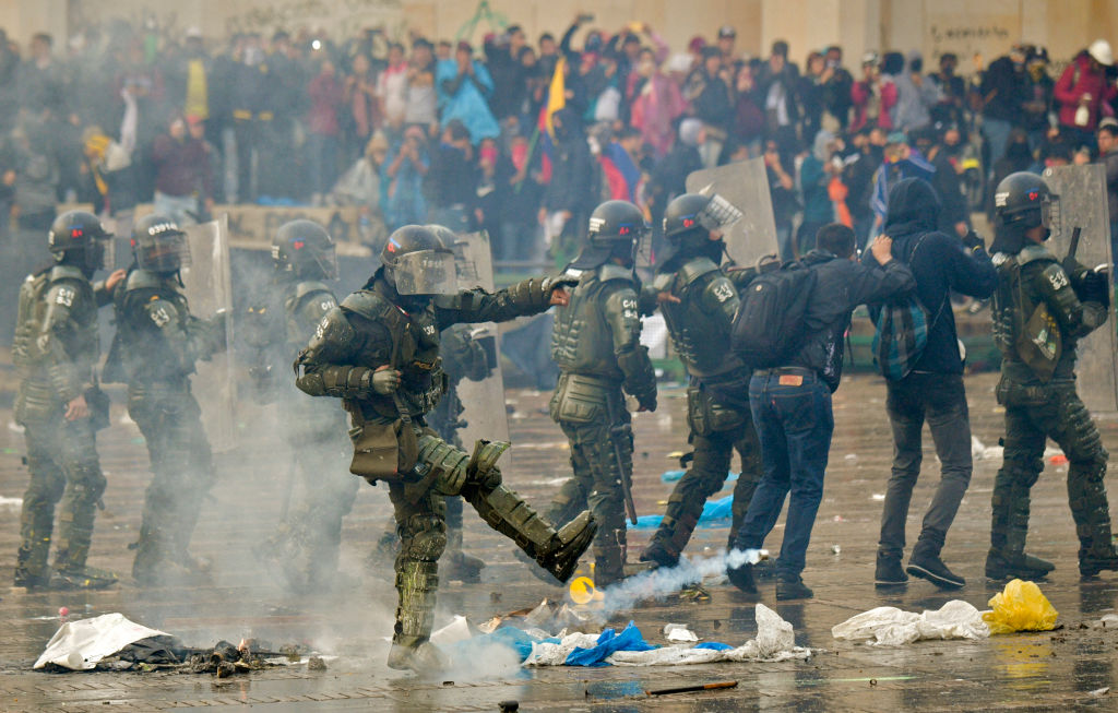 Riot police clash with demonstrators during a nationwide strike in Bogota, Colombia, on Nov. 21, 2019.