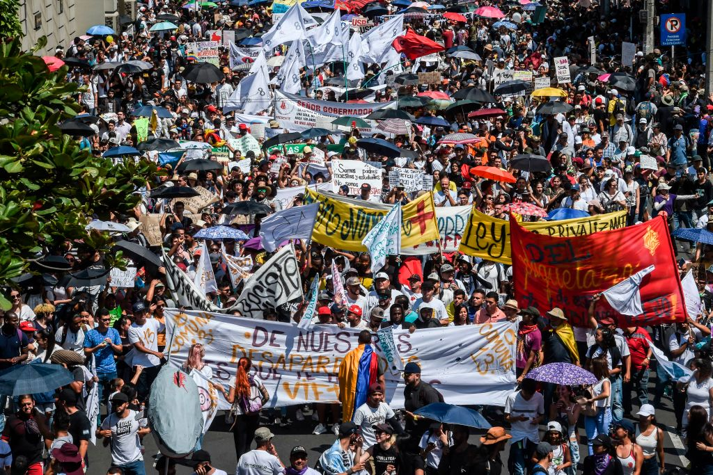 People march during a nationwide strike called by students, unions and indigenous groups to protest against the government of Colombia's President Ivan Duque in Medellin, Colombia, on Nov. 21, 2019.