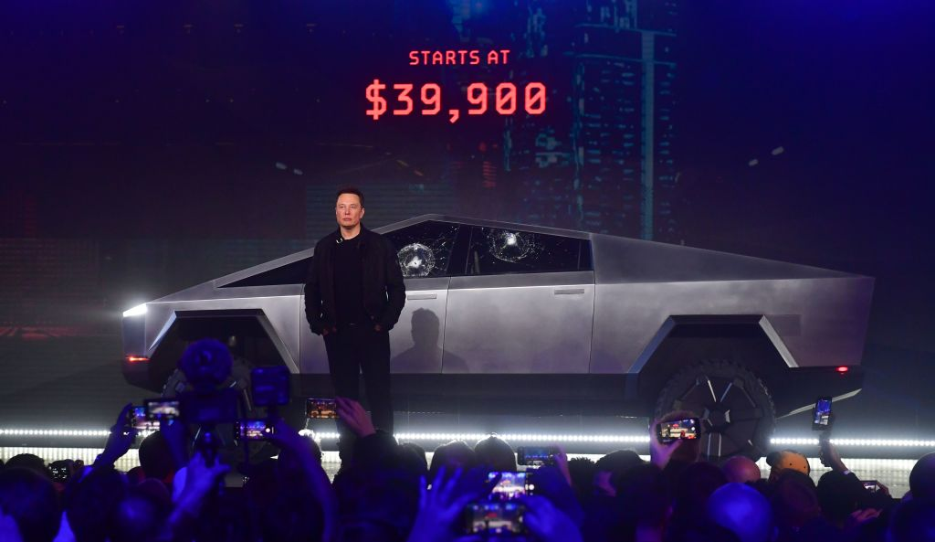 Tesla co-founder and CEO Elon Musk stands in front of the newly unveiled all-electric battery-powered Tesla's Cybertruck at Tesla Design Center in Hawthorne, California on Nov. 21, 2019.