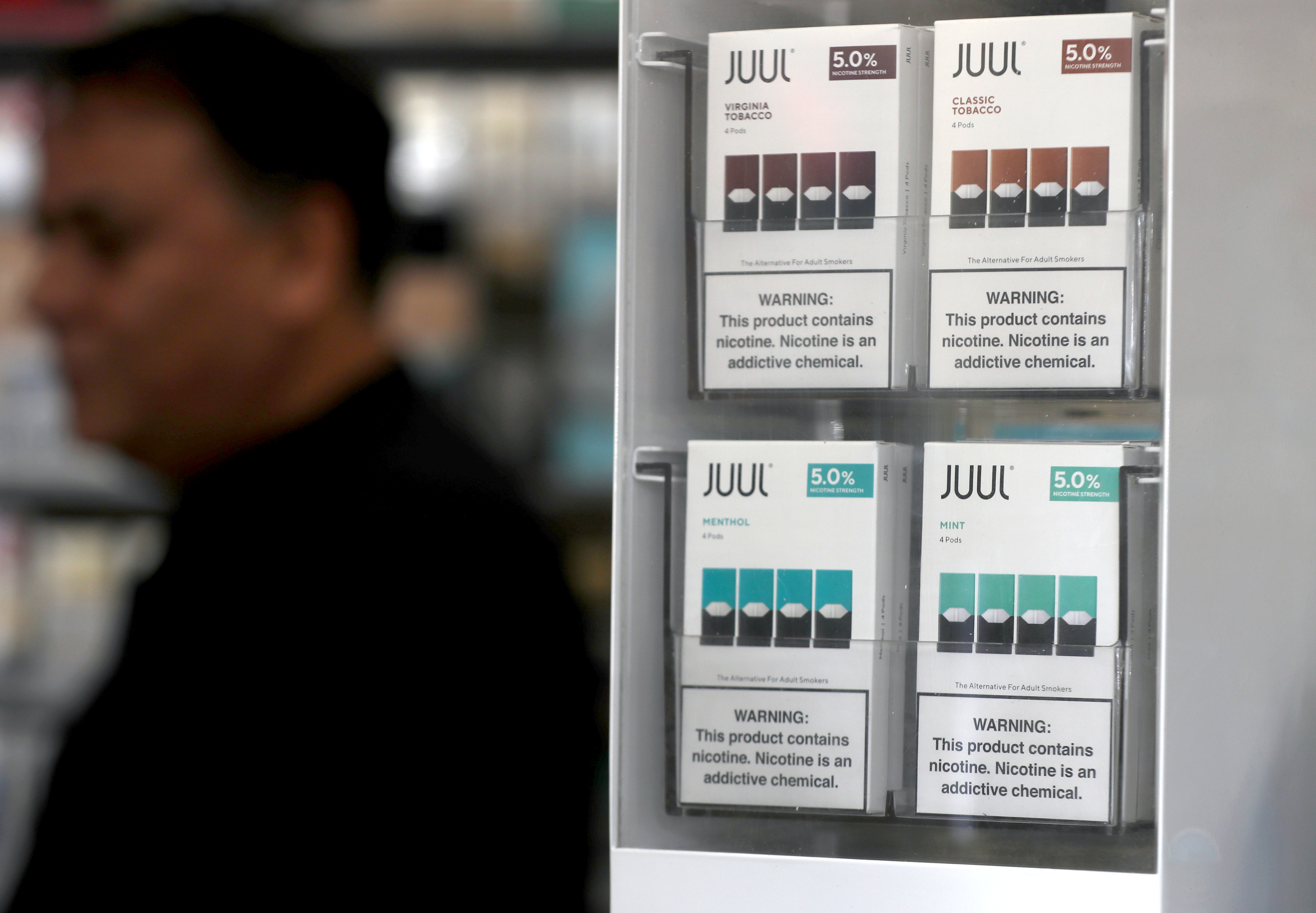 Packages of Juul mint flavored e-cigarettes are displayed at San Rafael Smokeshop on November 07, 2019 in San Rafael, California.