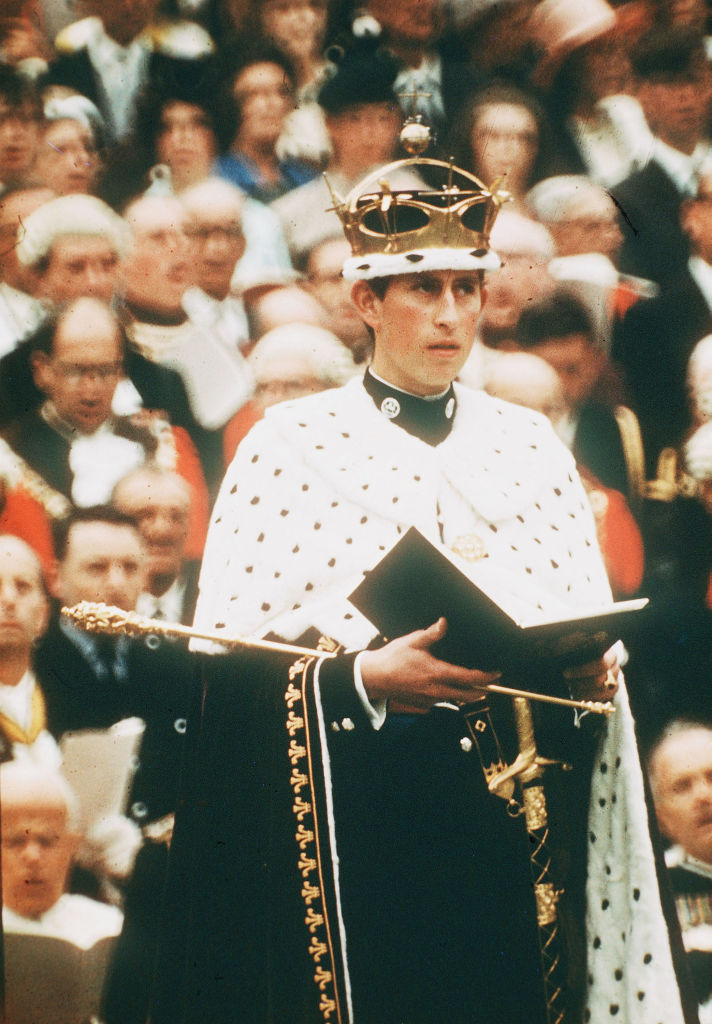 Prince Charles, wearing the gold coronet of the Prince of Wales, looks on at his investiture as Prince of Wales on July 1, 1969 in Caernarvon, Wales.