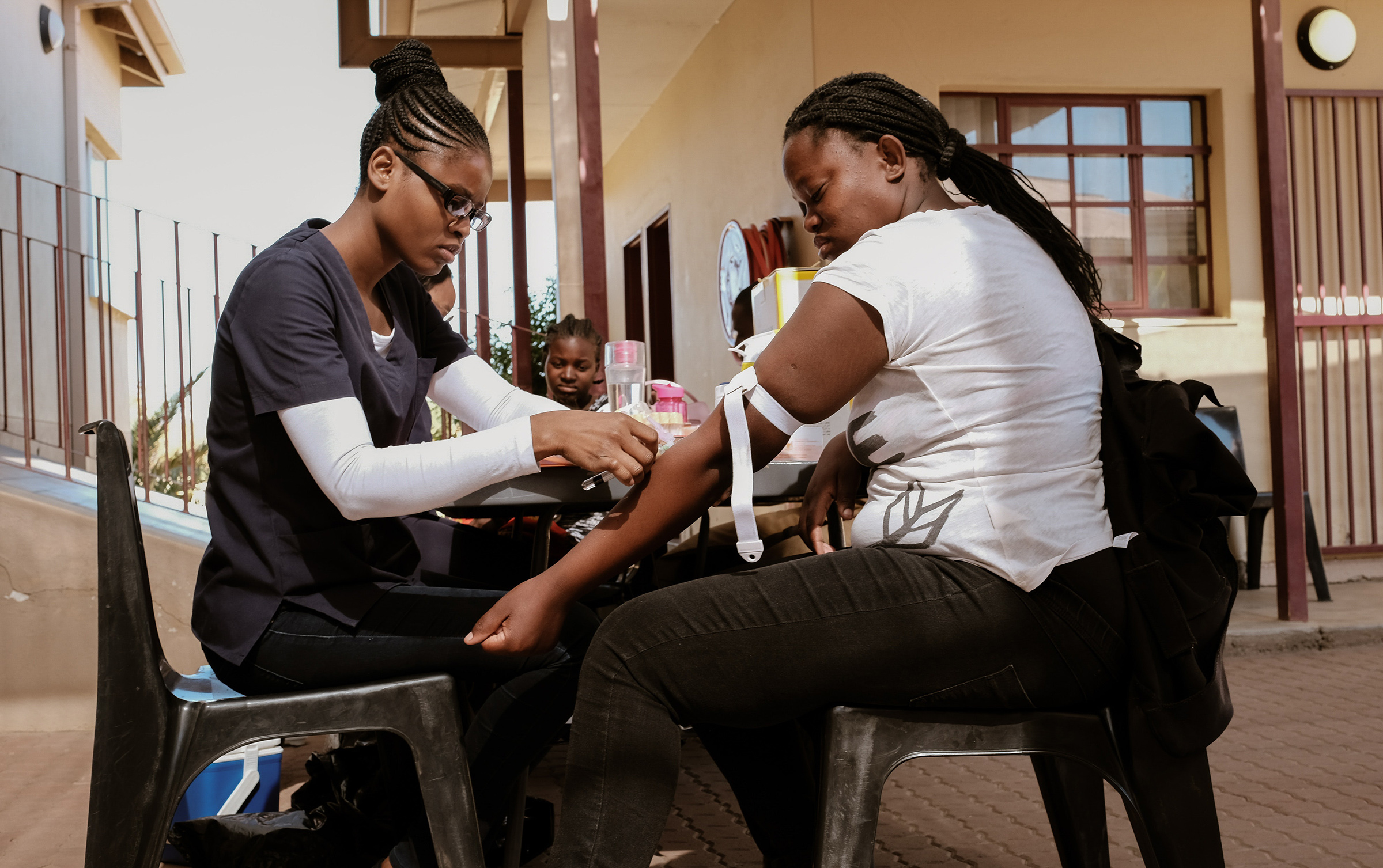Njandereeko get her blood withdrawn for HIV monitoring in Windhoek, Namibia during the summer of 2019. DREAMS program attendees are given free medical services of HIV testing, medical assistance, counseling and family planning tools throughout the program.