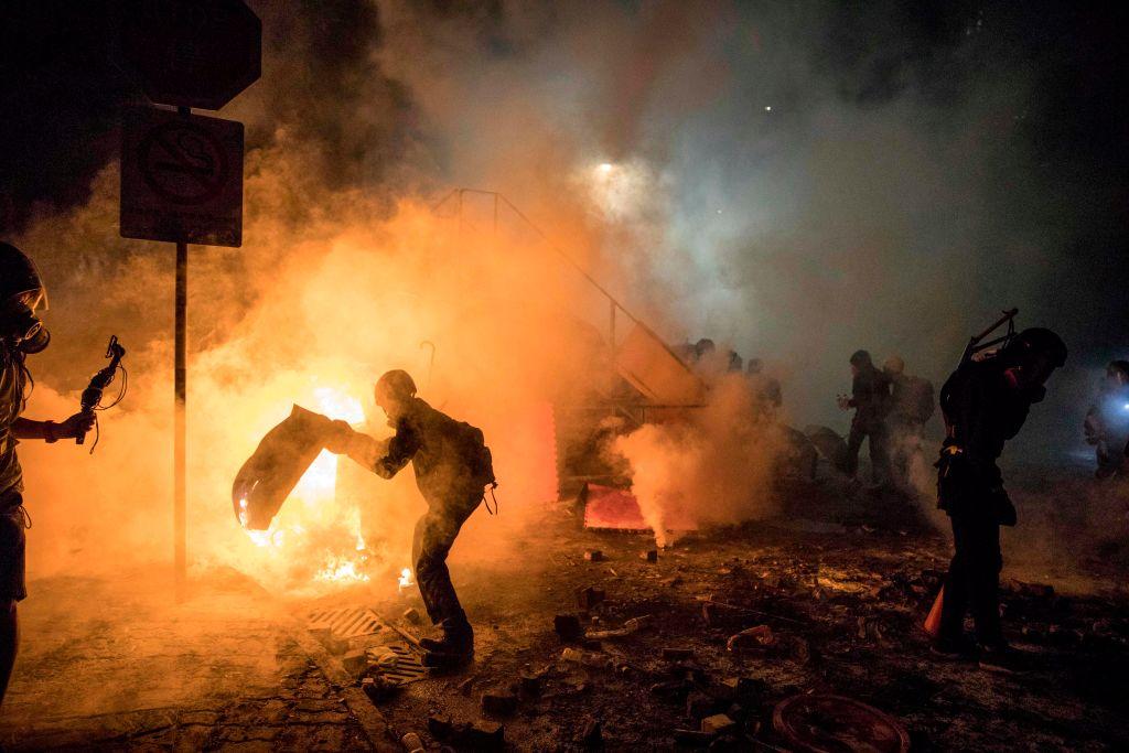 A barricade burns as protesters and police clash at the Chinese University of Hong Kong (CUHK) in Hong Kong on Nov. 12, 2019.