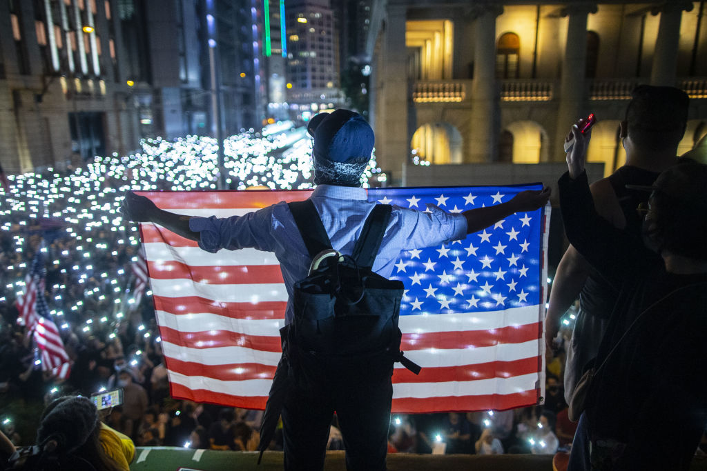 A demonstrator holds a U.S. flag during a rally in Hong Kong on Oct. 14, 2019.