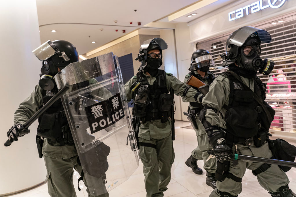 Riot police secure an area in a shopping mall during a demonstration in Hong Kong on November 10, 2019.