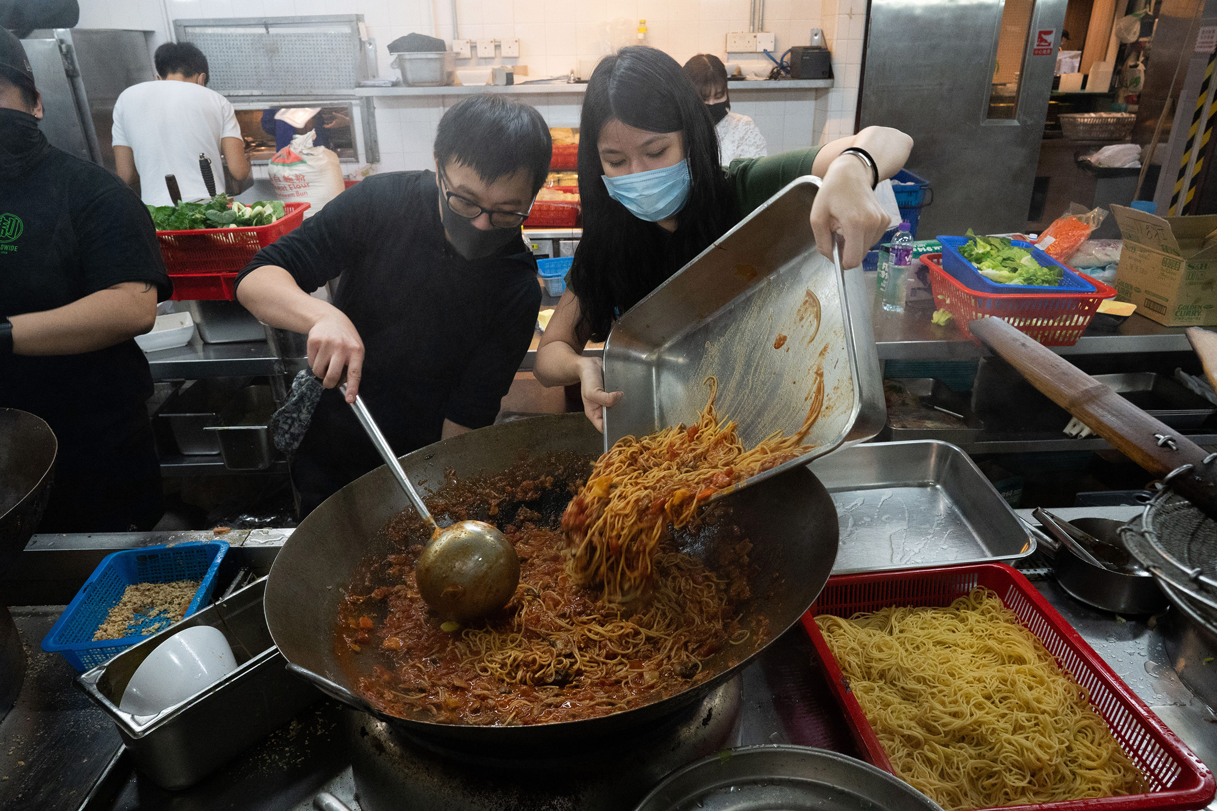 Volunteers, some of whom had never cooked before, help prepare food for the protestors gathered at PolyU, Nov. 14.