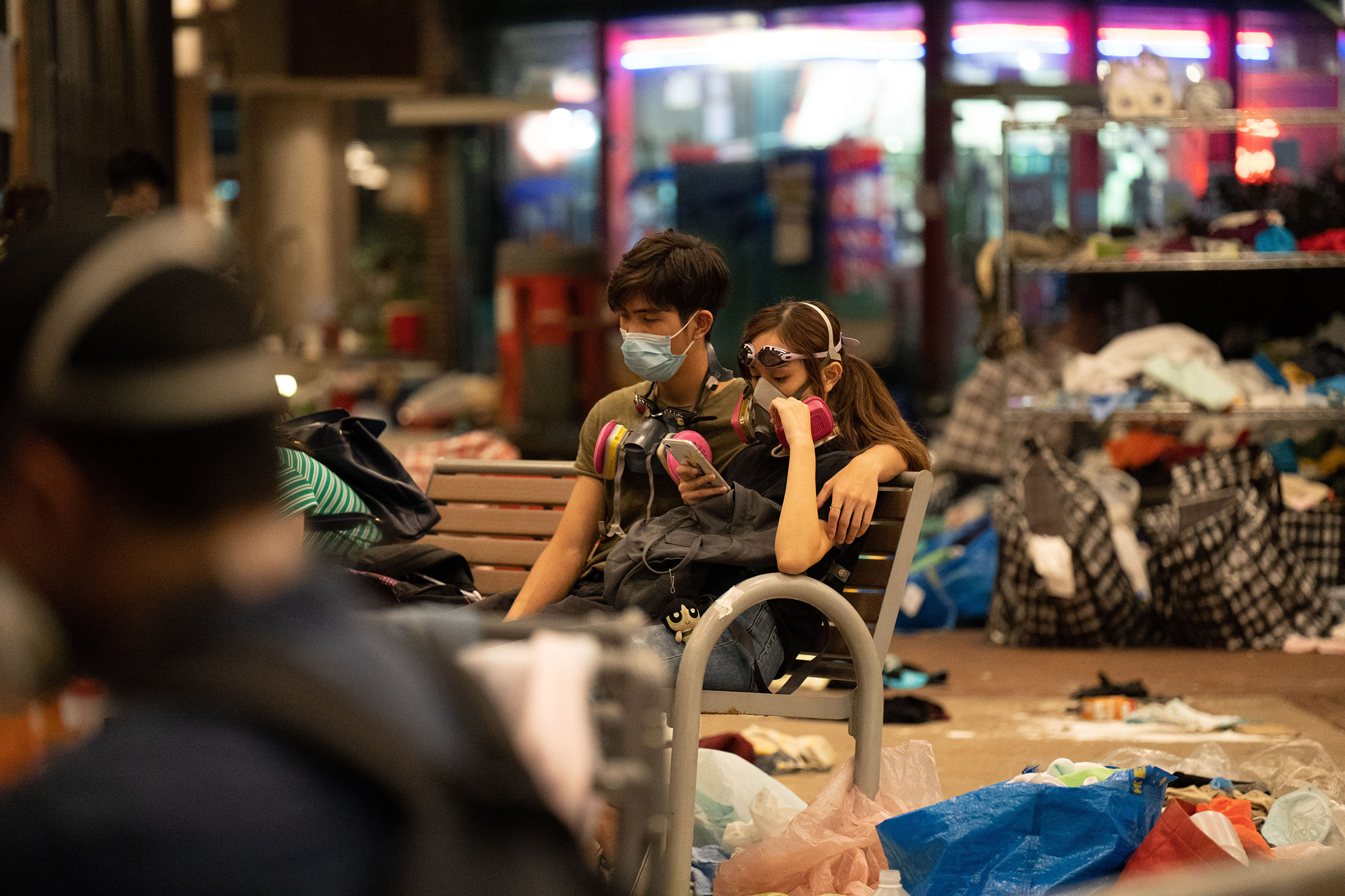 A couple waits for news of a rescue operation for protestors still trapped in PolyU, Nov. 18.