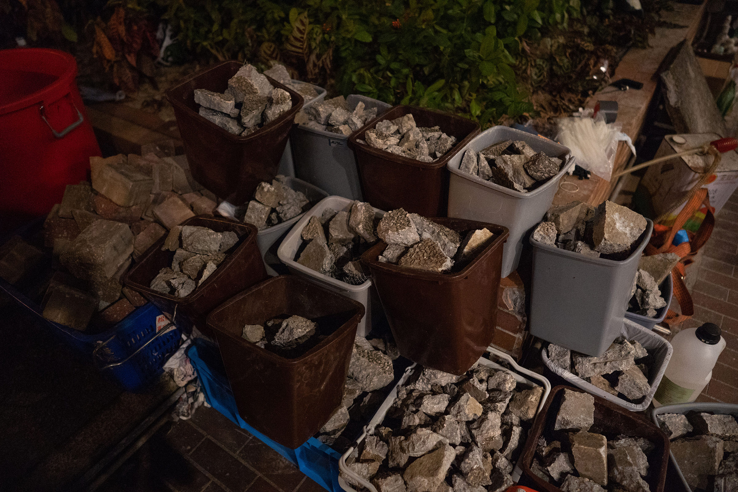 Bricks, used both to slow down advancing police as well as projectiles, are neatly sorted into garbage bins at PolyU.