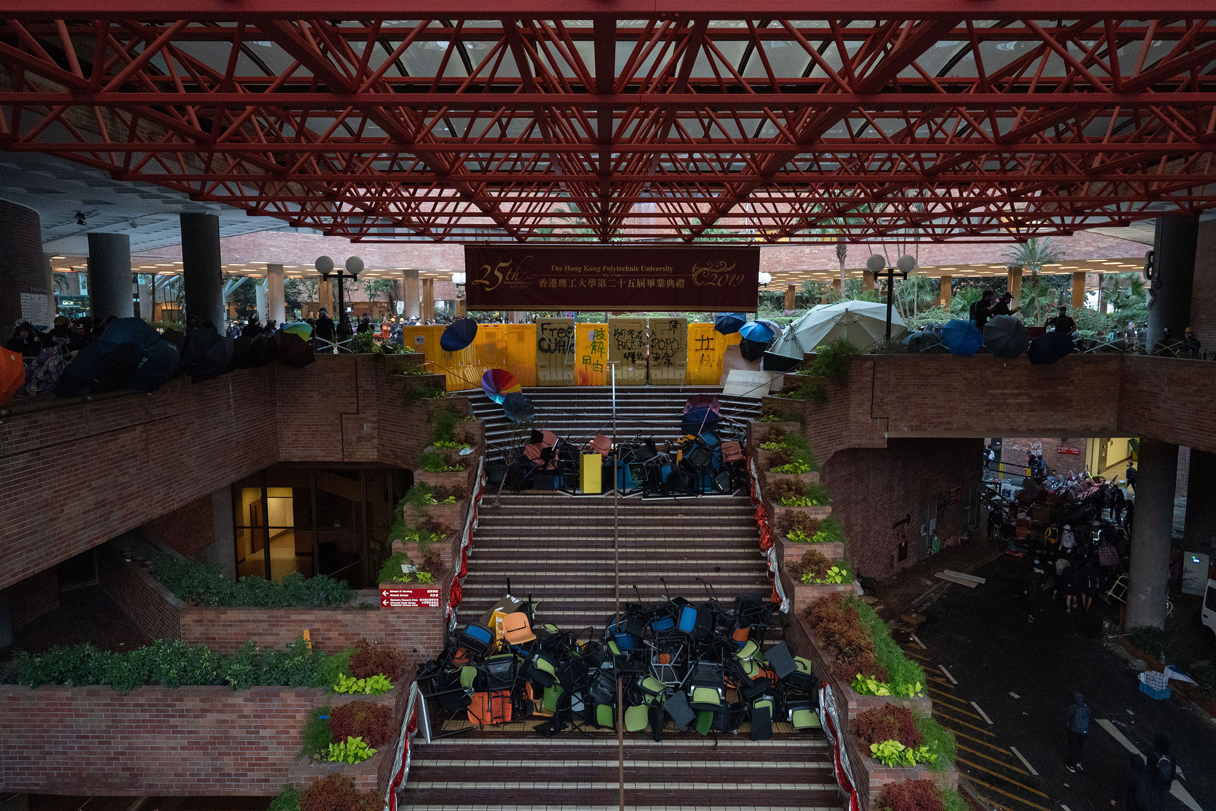Polytechnic University's main atrium, fortified with umbrellas and barricades, Nov. 14.