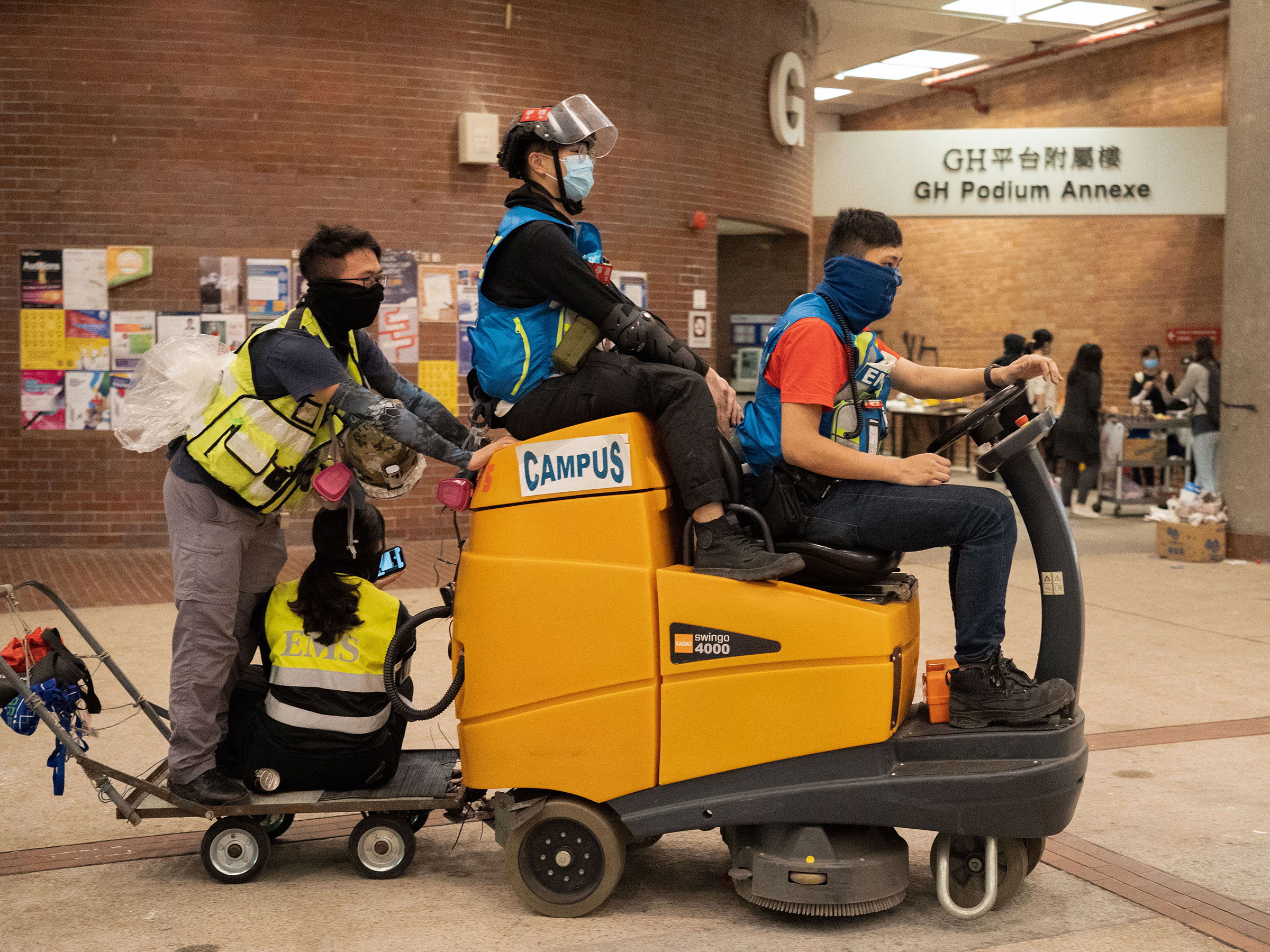 First-aiders convert a floor cleaning machine into a makeshift ambulance, Nov. 14.