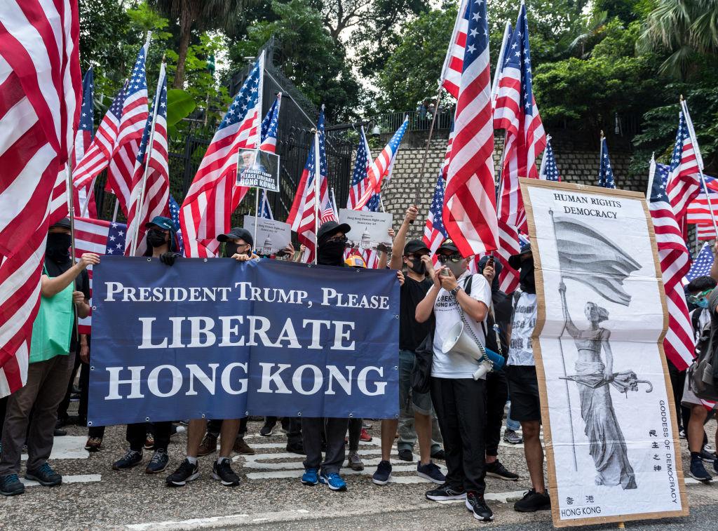 Protesters wave American flags while carrying placards urging the U.S. to enact the  Hong Kong Human Rights and Democracy Act  during a rally in Hong Kong on Sept. 8, 2019.