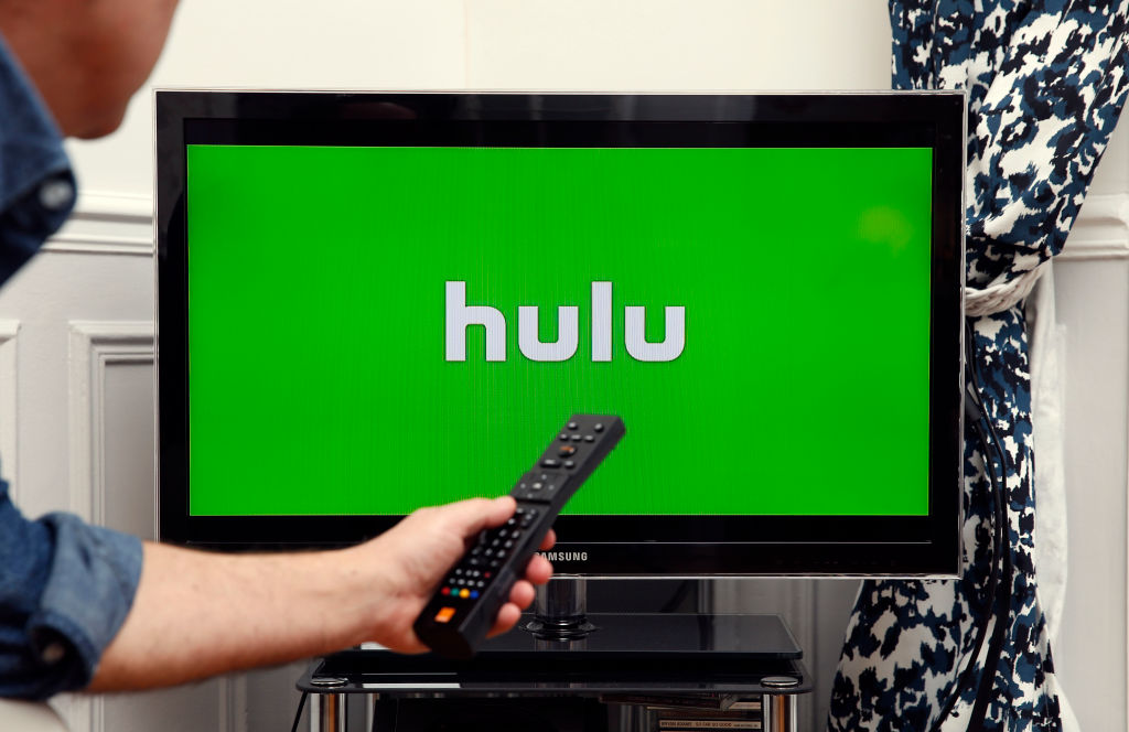 PARIS, FRANCE - JANUARY 10: In this photo illustration, the Hulu media service provider's logo is displayed on the screen of a television on January 10, 2019 in Paris, France. Hulu, a streaming video service competing with Netflix and Amazon Prime Video, announced in a statement released on Tuesday that it has surpassed 25 million subscribers and has gained 8 million users in a year in the United States by 2018. Hulu is a US subscription-based video-on-demand website that offers movies, TV shows and music videos. (Photo by Illustration by Chesnot/Getty Images)