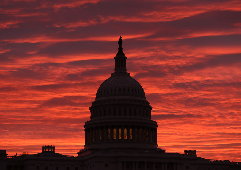 The sky turns to a fiery color as the sun begins to rise behind the U.S. Capitol building, on November 7, 2019 in Washington, D.C.