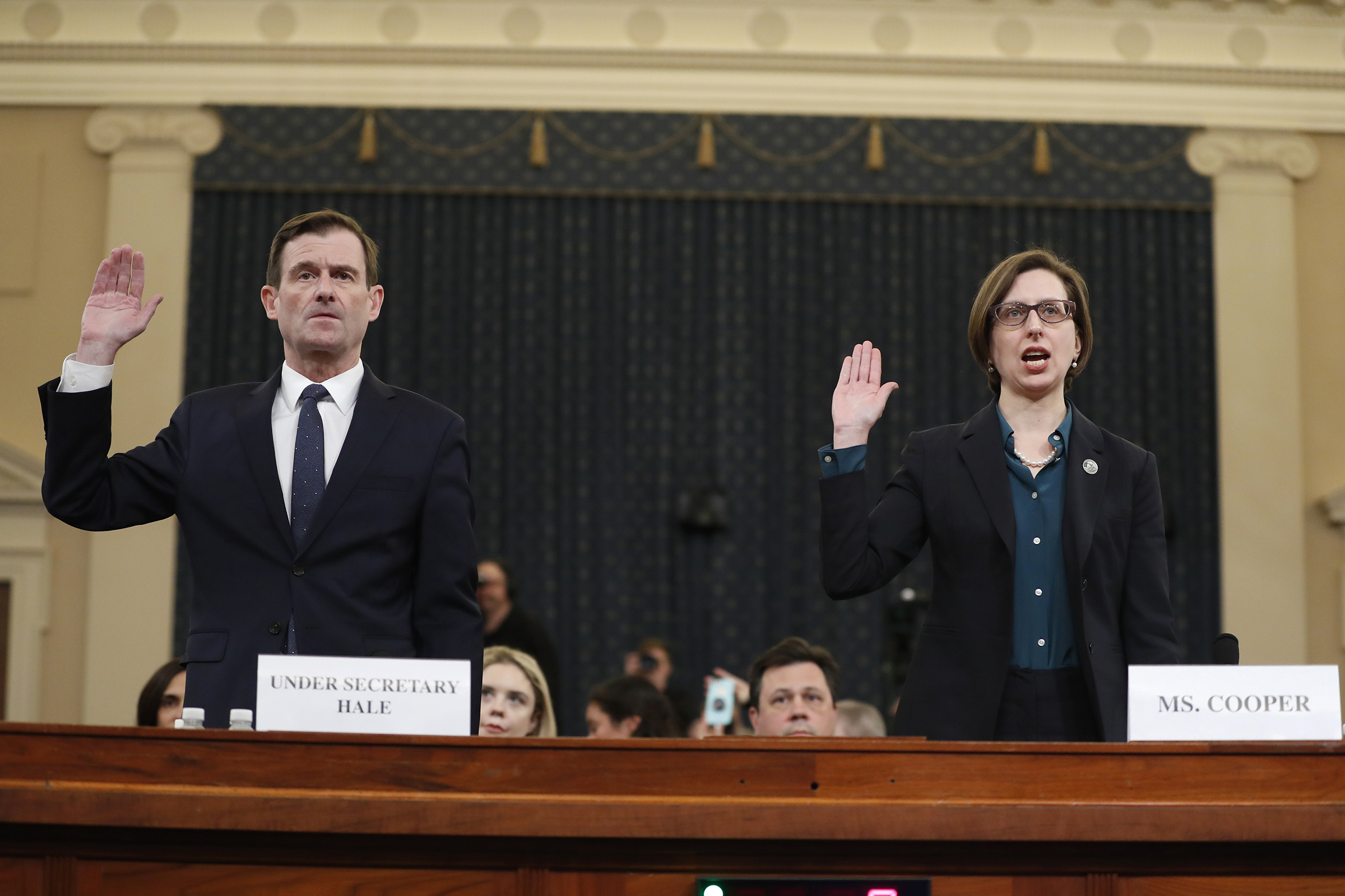 Deputy Assistant Secretary of Defense Laura Cooper, right, and State Department official David Hale, are sworn in to testify before the House Intelligence Committee on Capitol Hill in Washington D.C. on Nov. 20, 2019.