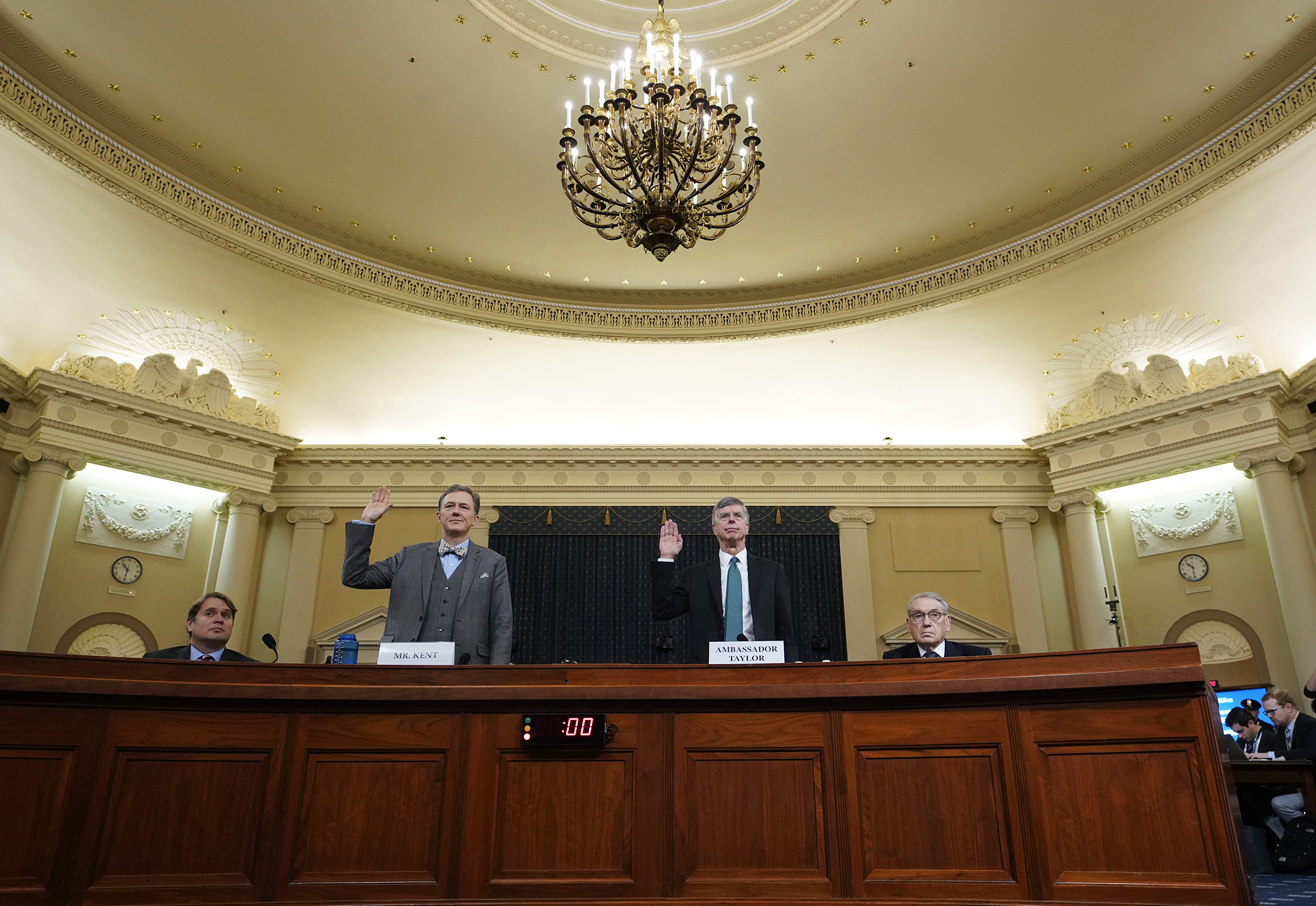 (L-R) Deputy Assistant Secretary for European and Eurasian Affairs George P. Kent and top U.S. diplomat in Ukraine William B. Taylor Jr. are sworn-in prior to testifying before the House Intelligence Committee in the Longworth House Office Building on Capitol Hill on Nov. 13, 2019.