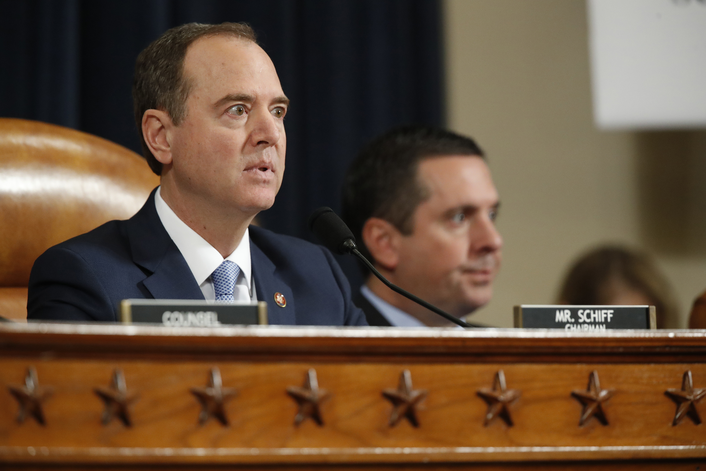 House Intelligence Committee Chairmen Rep. Adam Schiff, D-Calif., left, gives opening remarks as ranking member Rep. Devin Nunes, R-Calif., left, looks on, before former Ambassador to Ukraine Marie Yovanovitch testifies before the House Intelligence Committee on Capitol Hill in Washington, on Nov. 15, 2019.