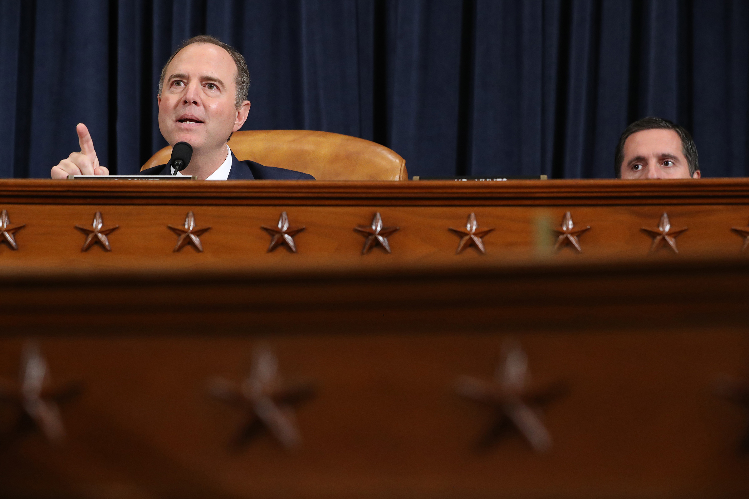 House Intelligence Committee Chairman Rep. Adam Schiff (D-CA) (L) delivers closing remarks as ranking member Rep. Devin Nunes (R-CA) listens at the end of an impeachment inquiry hearing on Capitol Hill on Nov. 21, 2019 in Washington, DC.
