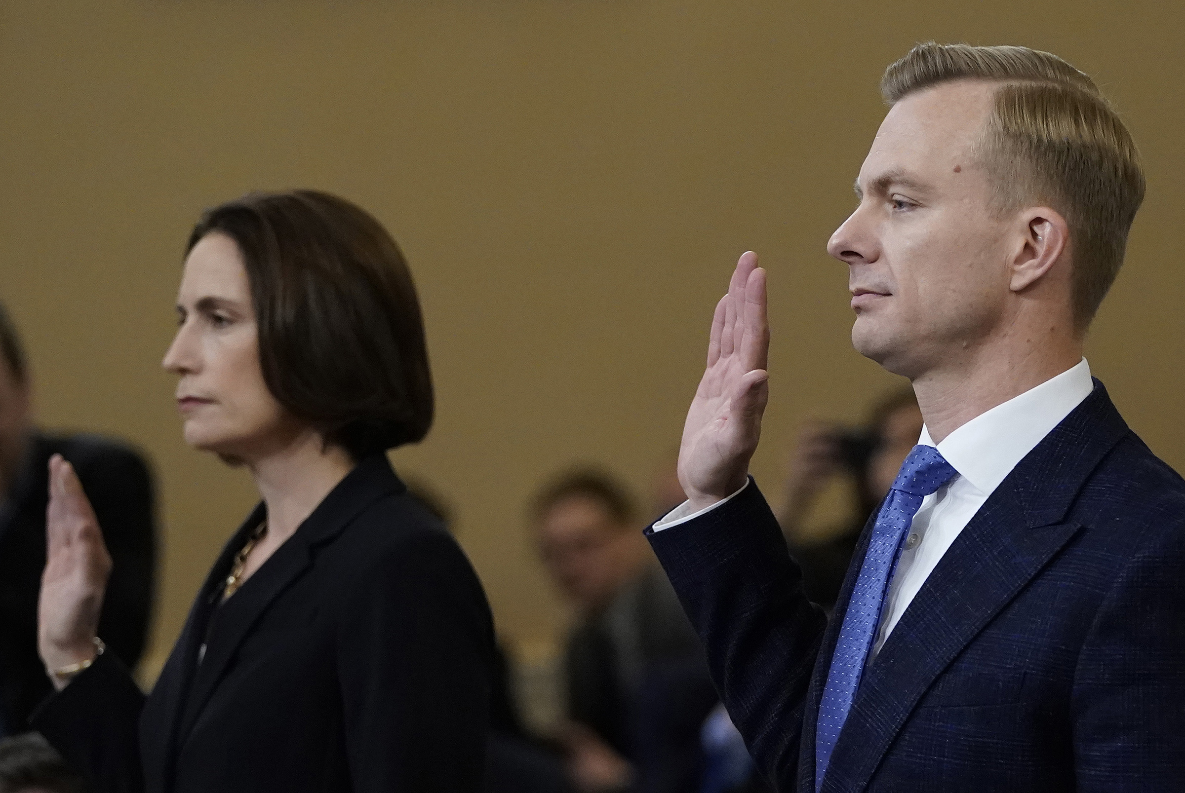 Fiona Hill, the National Security Council's former senior director for Europe and Russia, and David Holmes, an official from the American embassy in Ukraine, are sworn in prior to testifying before the House Intelligence Committee on Capitol Hill on Nov. 21, 2019.