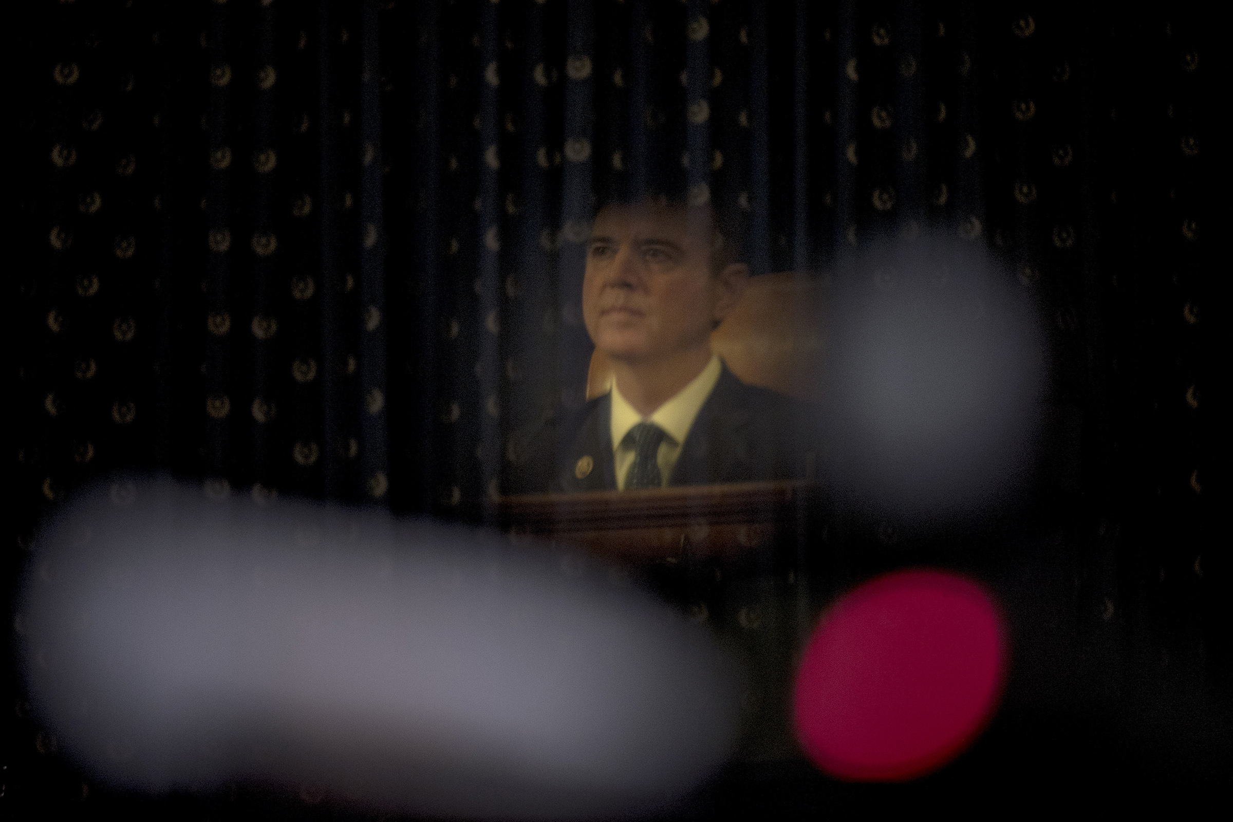 A reflection of Chairman Adam Schiff (D-Calif.) listening to testimony during the House Intelligence Committee hearing on the impeachment inquiry on Capitol Hill in Washington D.C., on Nov. 19, 2019.