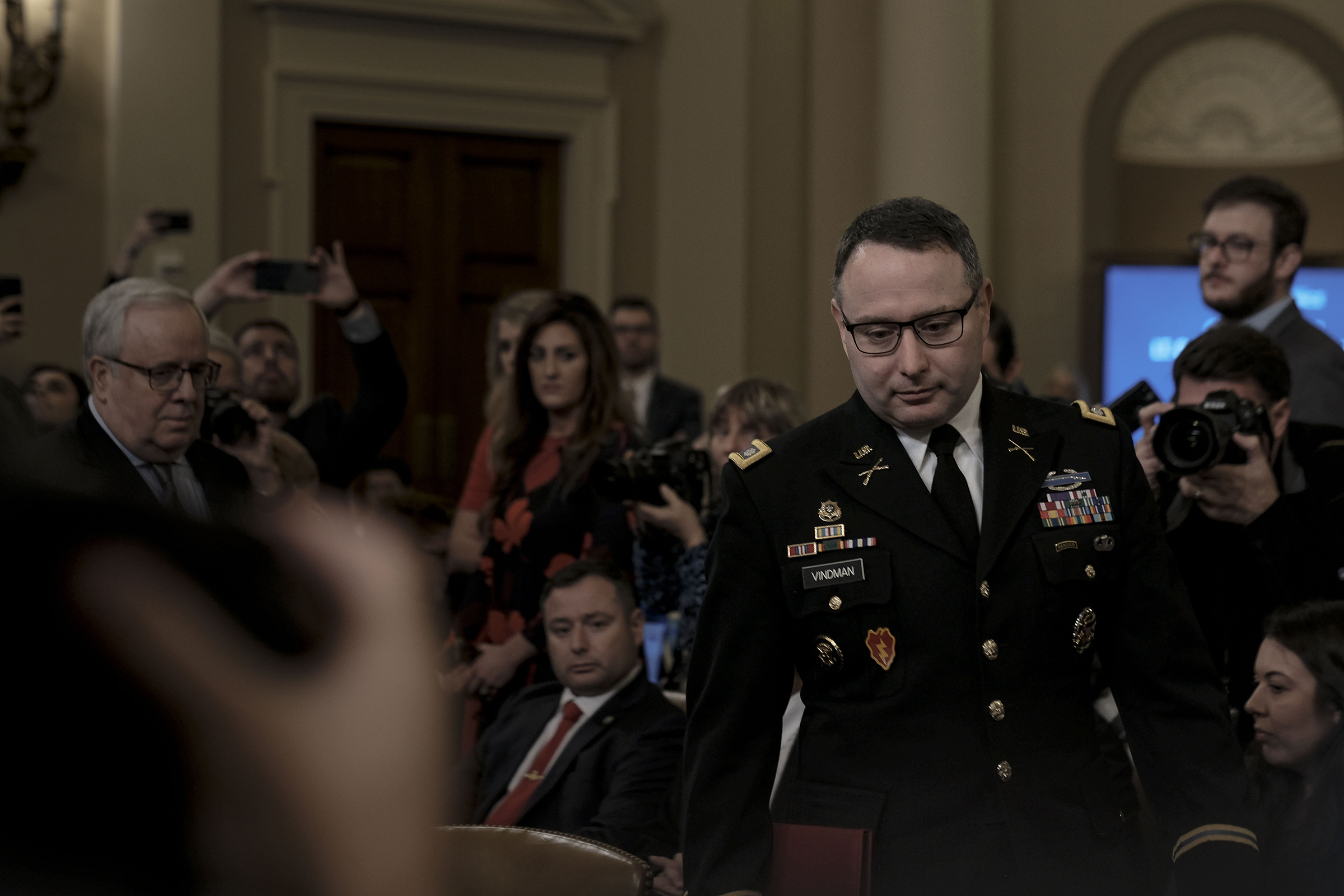 Witness Lt. Col. Alexander Vindeman, National Security Council staffer, enters the House Intelligence Committee hearing on the impeachment inquiry on Capitol Hill in Washington, D.C. on Nov. 19, 2019. Gabriella Demczuk / TIME