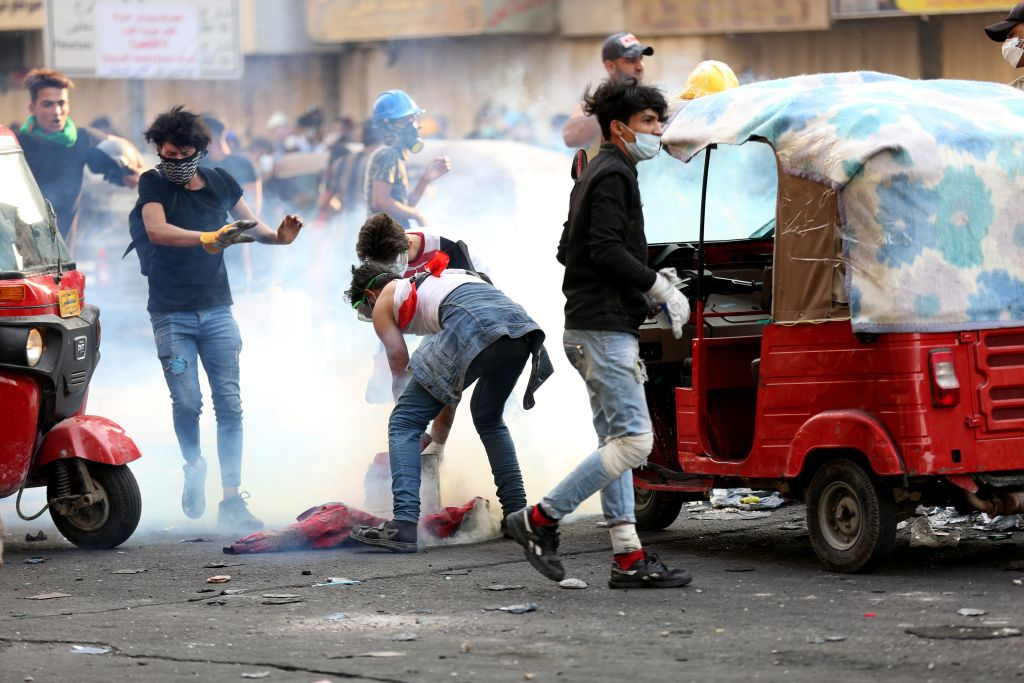 Demonstrators clash with Iraqi security forces during the ongoing anti-government protests in Baghdad on Nov. 12, 2019.