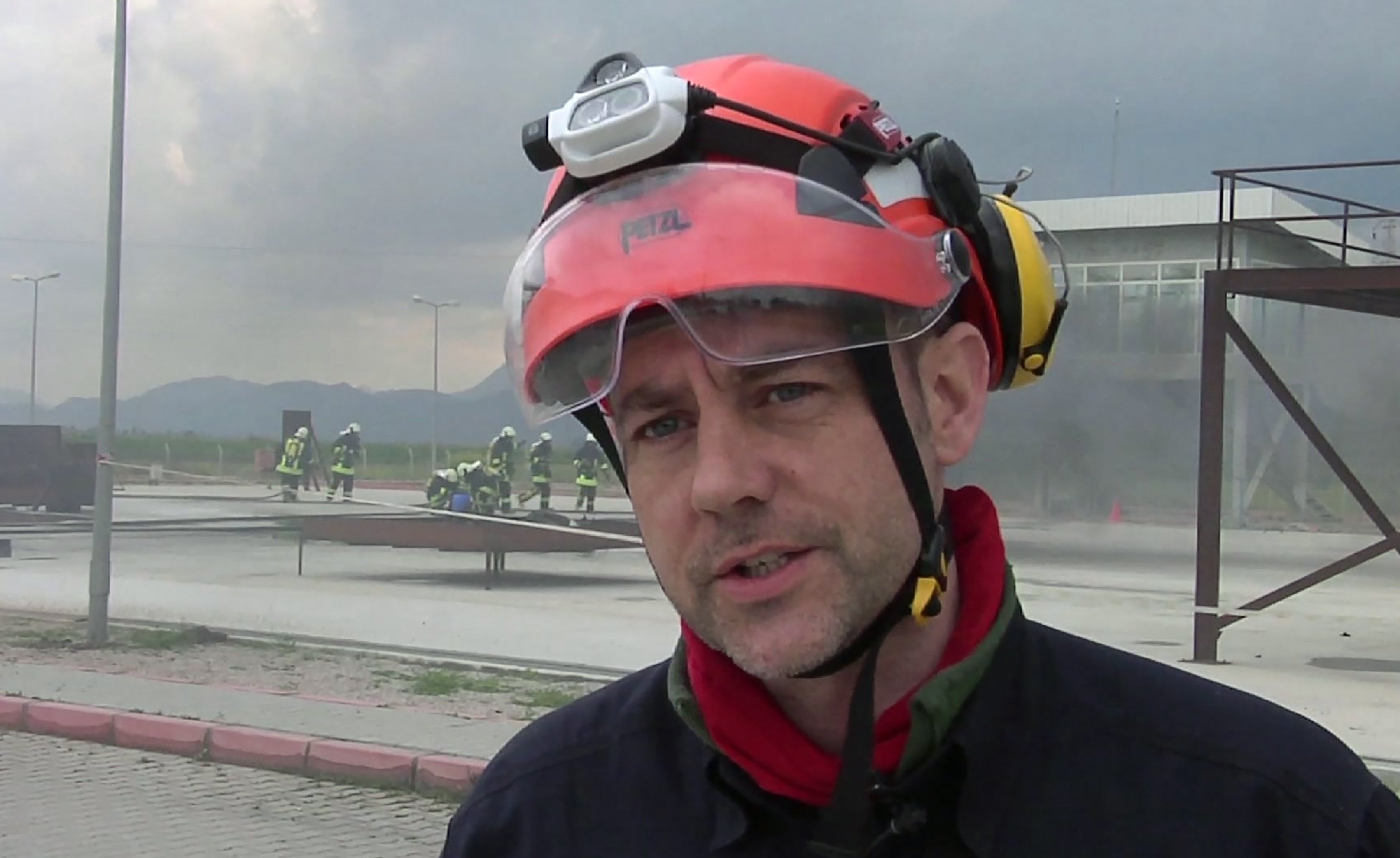 FILE - In this image taken from file video, showing James Le Mesurier, founder and director of Mayday Rescue, talks to the media during training exercises in southern Turkey, March 19, 2015.  Turkey's state-run news agency report Monday Nov. 11, 2019, that a former British army officer who helped found the  White Helmets  volunteer organisation in Syria, has been found dead in Istanbul. (AP Photo, FILE)