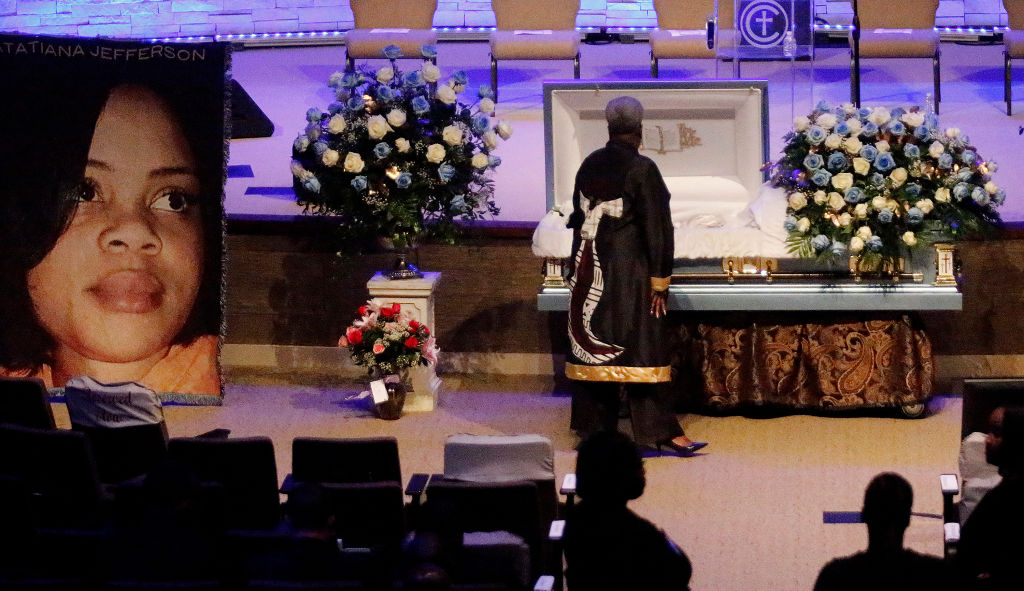 A mourner pays respects before the start of the funeral service for Atatiana Jefferson on Oct. 24, 2019, at Concord Church in Dallas, Texas.