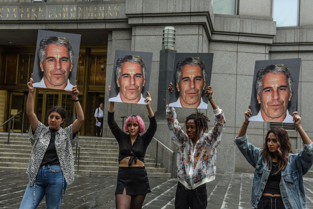A protest group called  Hot Mess  hold up signs of Jeffrey Epstein in front of the Federal courthouse on July 8, 2019 in New York City.