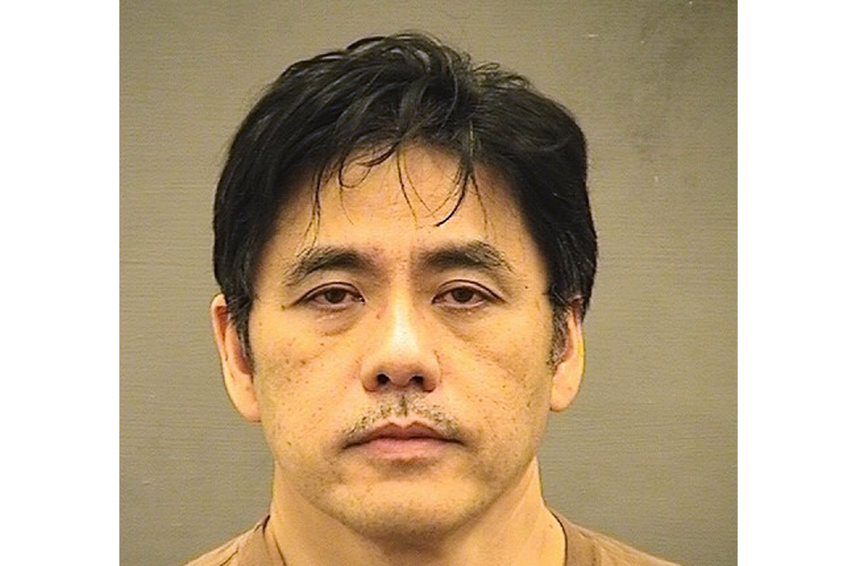 This undated file photo provided by the Alexandria Sheriff's Office shows Jerry Chun Shing Lee. The former CIA officer who pleaded guilty to an espionage conspiracy with China could be facing more than two decades in prison. Fifty-five-year-old Lee is scheduled for sentencing Friday, Nov. 22, 2019, in federal court in Alexandria, Va.