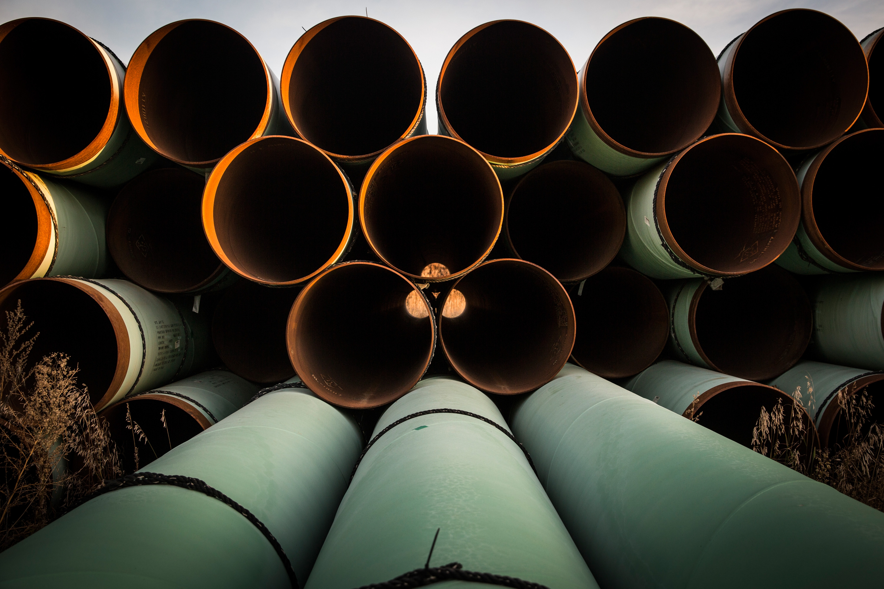 Miles of unused pipe, prepared for the proposed Keystone XL pipeline, sit in a lot on October 14, 2014 outside Gascoyne, North Dakota.