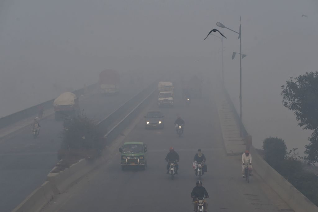Commuters drive amid heavy smog conditions in Lahore, Pakistan on Nov. 21, 2019.