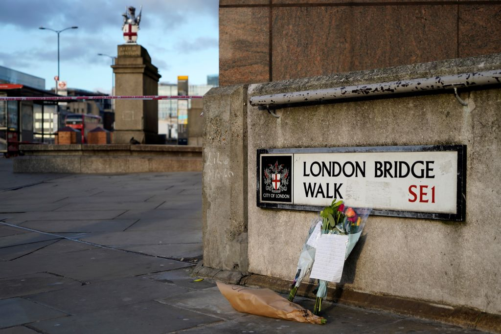 Floral tributes are pictured close to London Bridge in the City of London, on November 30, 2019, following the November 29 terror incident in which two people died after being stabbed on the bridge.