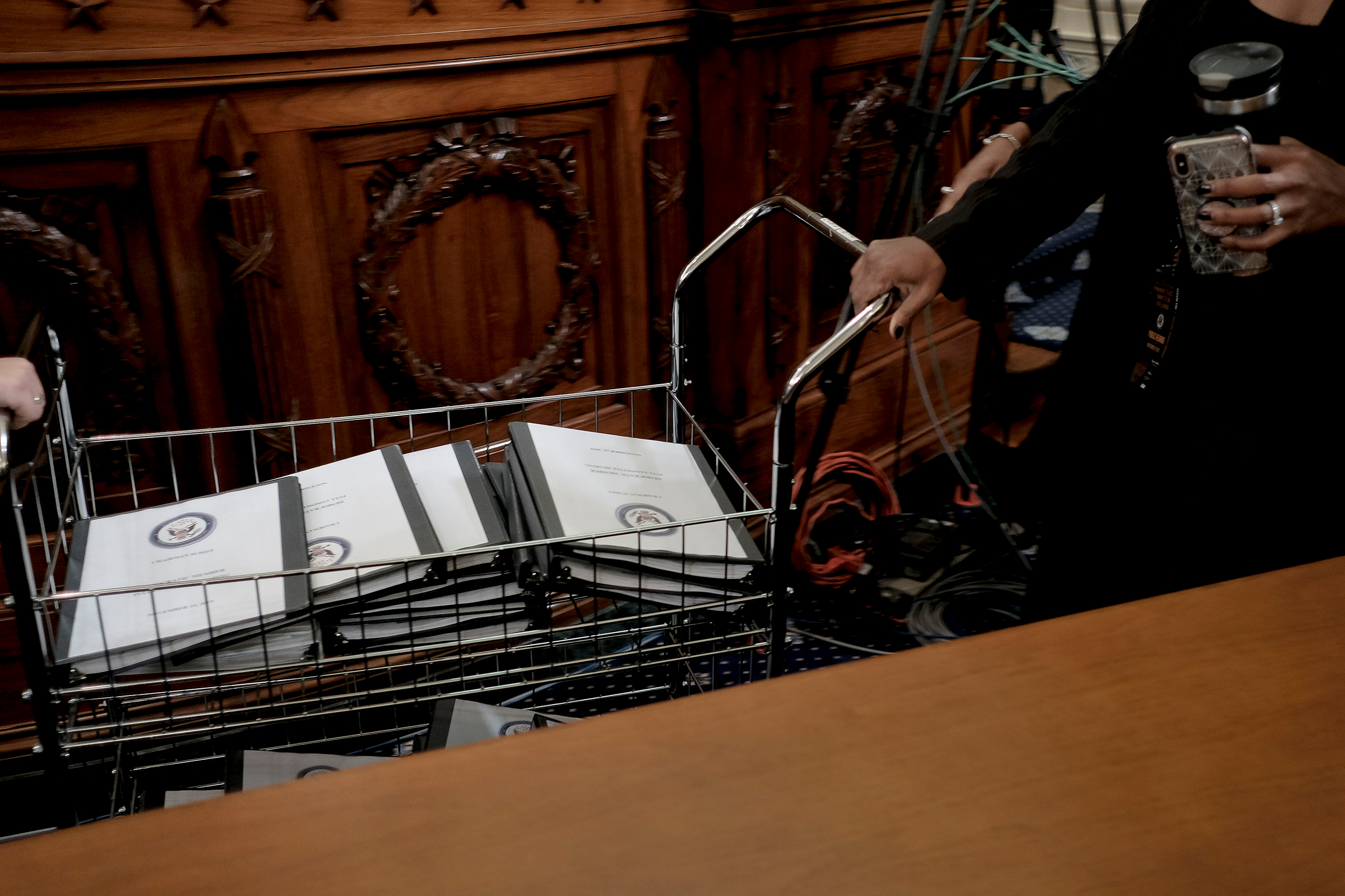 Binders full of notes, testimonies, talking points and more are distributed for Democratic members of Congress at the House Intelligence Committee hearing on the impeachment inquiry, in Washington, D.C., on Nov. 15, 2019.