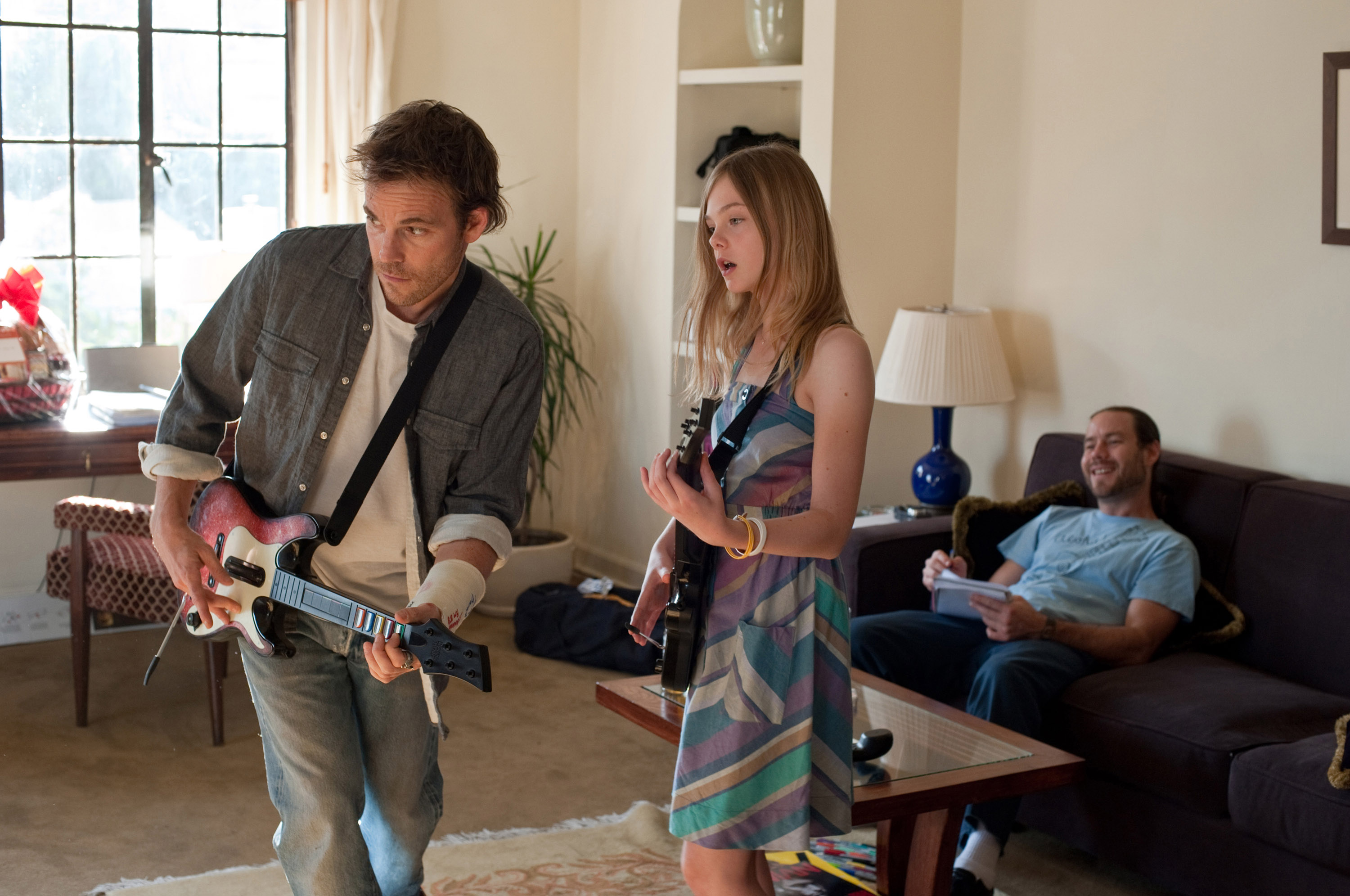 (L-R) Stephen Dorff, Elle Fanning, Chris Pontius in Somewhere.