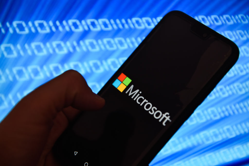 In this photo illustration, the Microsoft logo is seen displayed on an Android mobile phone.