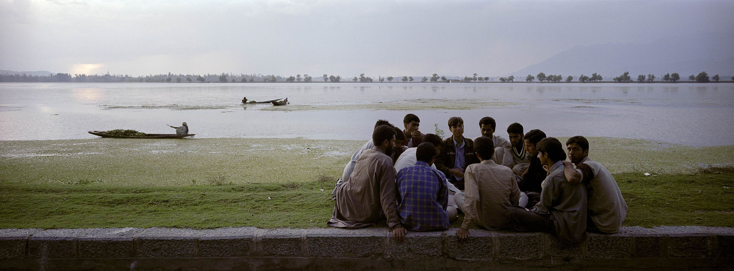 Young Kashmiris play a game of carrom on the bank of the Dal Lake in Srinagar, the capital of Jammu and Kashmir.