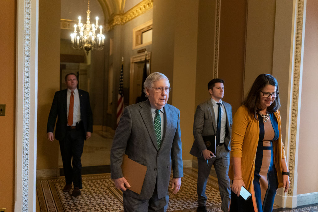 Senate Majority Leader Mitch McConnell (R-KY) walks from his office to the floor of the Senate to open the Senate for business on Nov. 21, 2019 in Washington, DC.