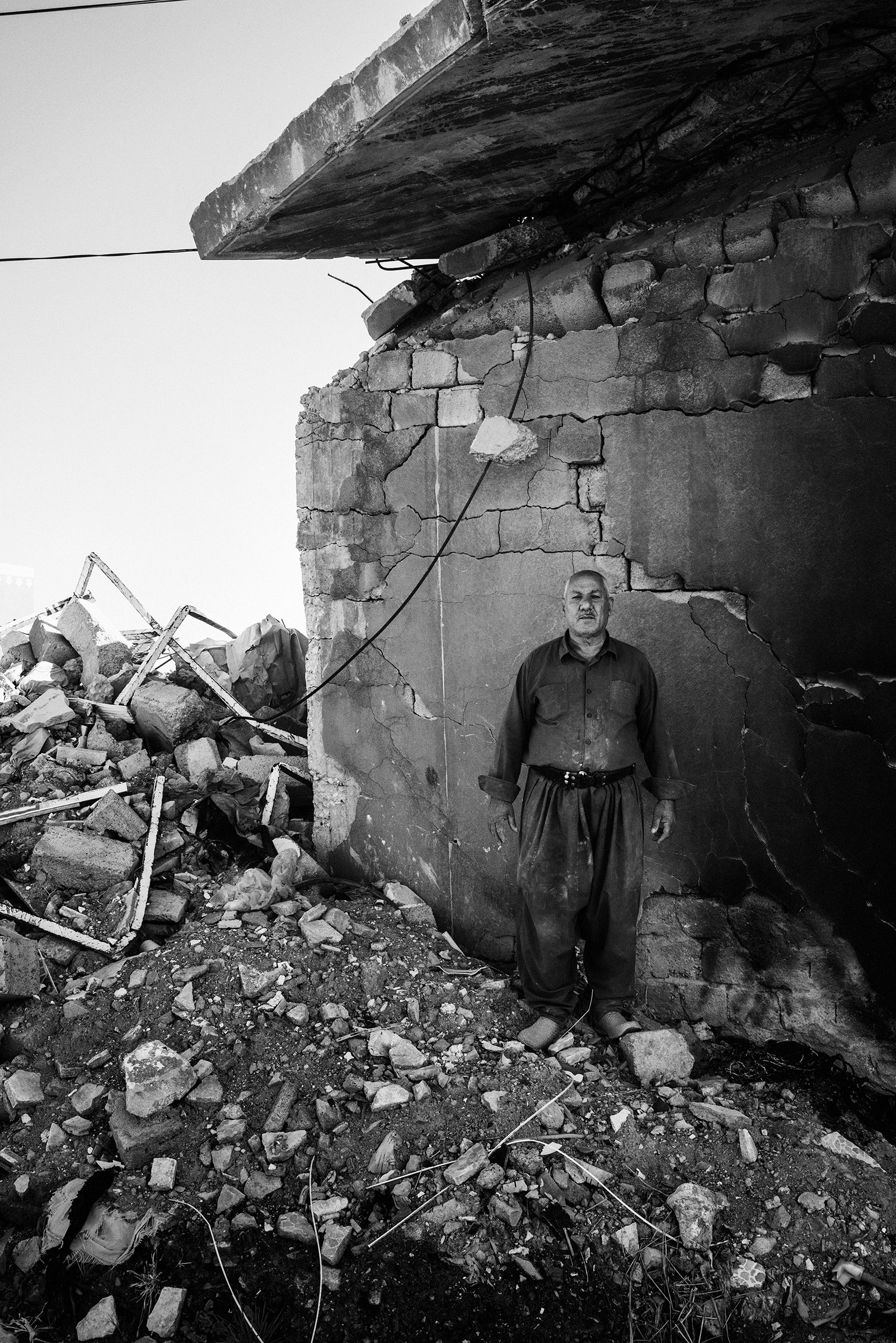 Mohsin Hairan Aswad, 60, a wealthy Yazidi Kurd from Bashiqa, stands in the remains of one of the seven homes that he owns. His homes were destroyed during the fighting to liberate the town from ISIS control in 2016. The next year, his son Faris, a local policeman in Mosul, was killed by an ISIS sniper.