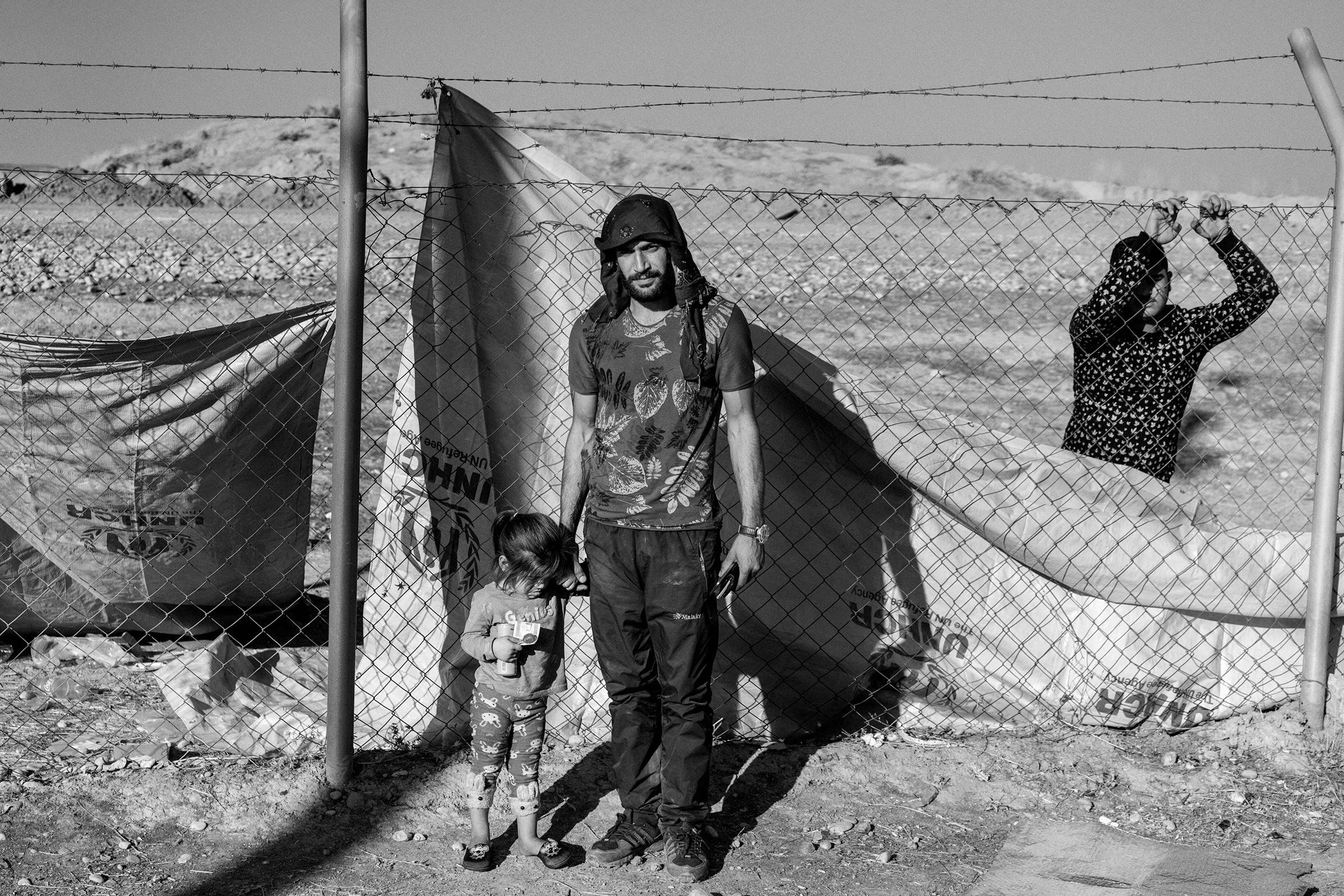 Hamza Mohammad Hamo, 29, with his daughter, Gulista, at the Bardarash camp. A former Syrian Kurdish fighter from Kobani, he arrived with his three-year-old after his wife left to join the fight against the Turkish invasion.