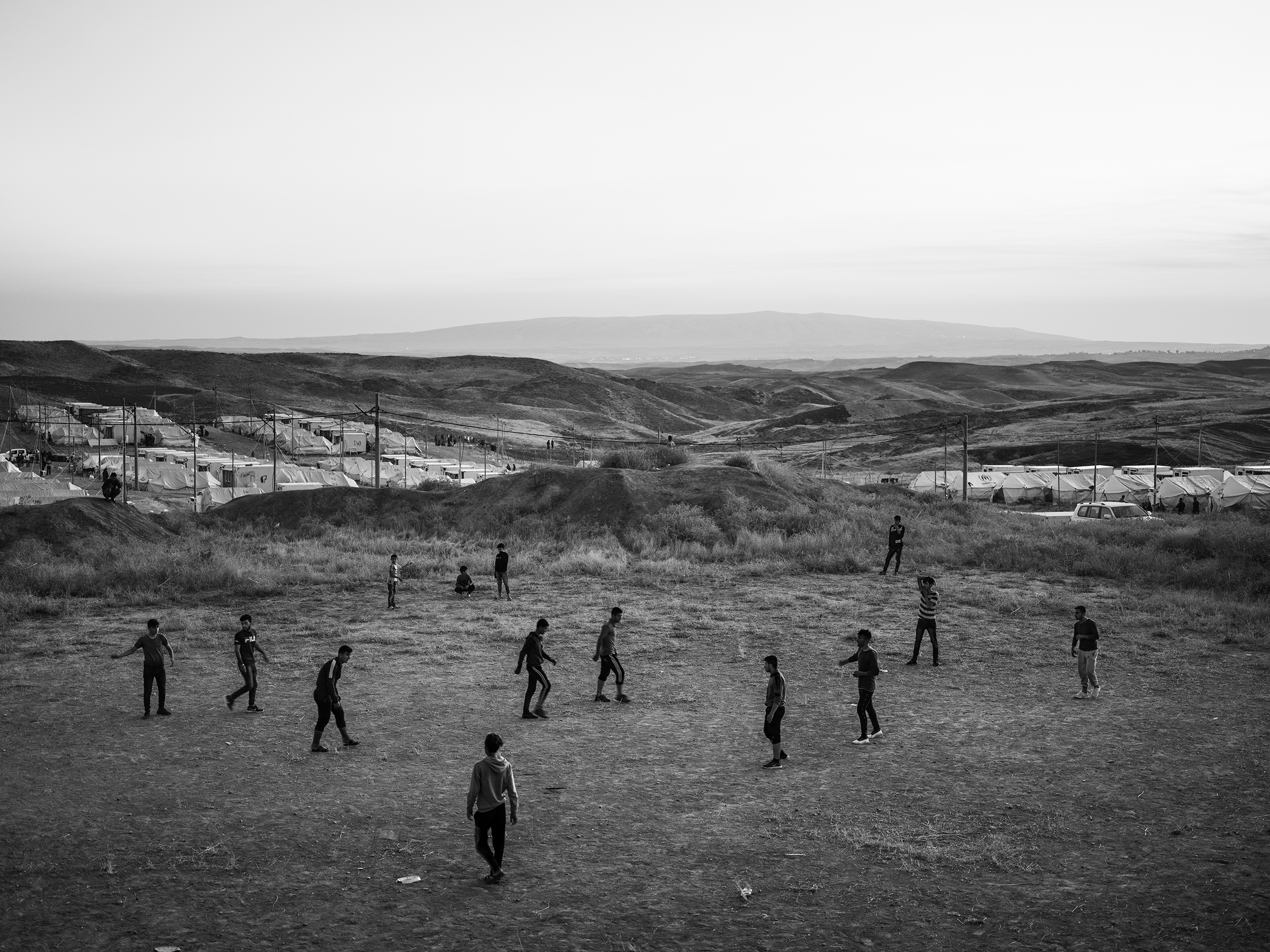 Refugees play soccer inside the Bardarash camp, which had hosted Iraqis displaced by the offensive against ISIS in Mosul and reopened in October to accommodate Kurds fleeing the Turkish offensive in Syria.
