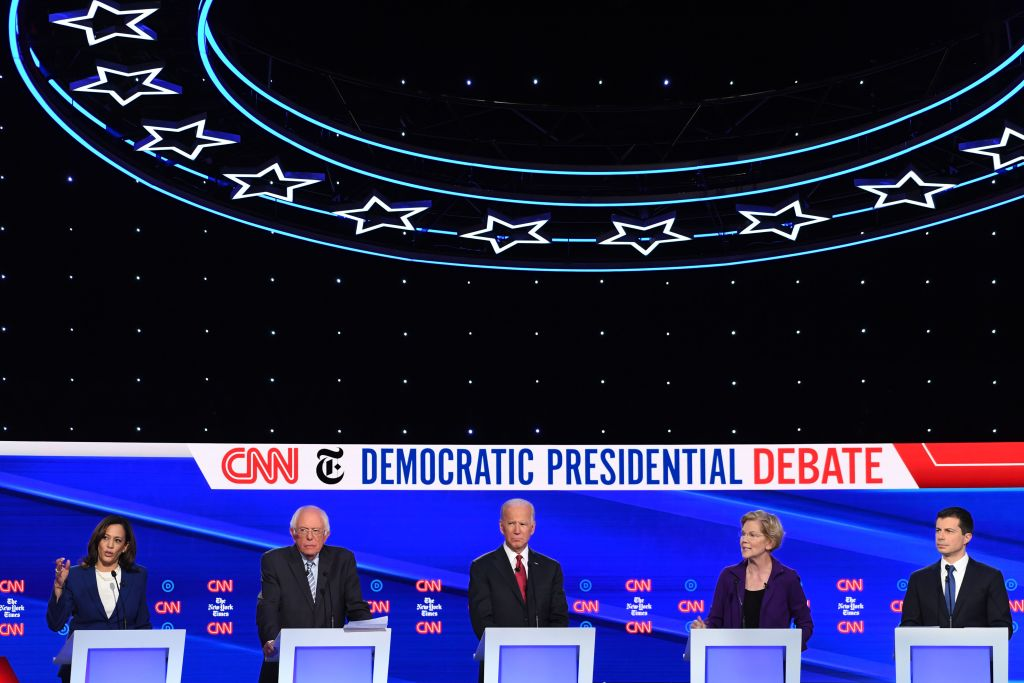 Democratic presidential hopeful California Senator Kamala Harris (L) speaks flanked by (from L) Vermont Senator Bernie Sanders, former US Vice President Joe Biden, Massachusetts Senator Elizabeth Warren and Mayor of South Bend, Indiana Pete Buttigieg during the fourth Democratic primary debate in Westerville, Ohio on October 15, 2019.