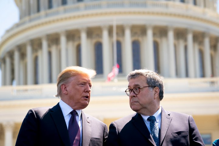 President Donald Trump and Attorney General William Barr talk while attending the 38th Annual National Peace Officers Memorial Service on Capitol Hill.